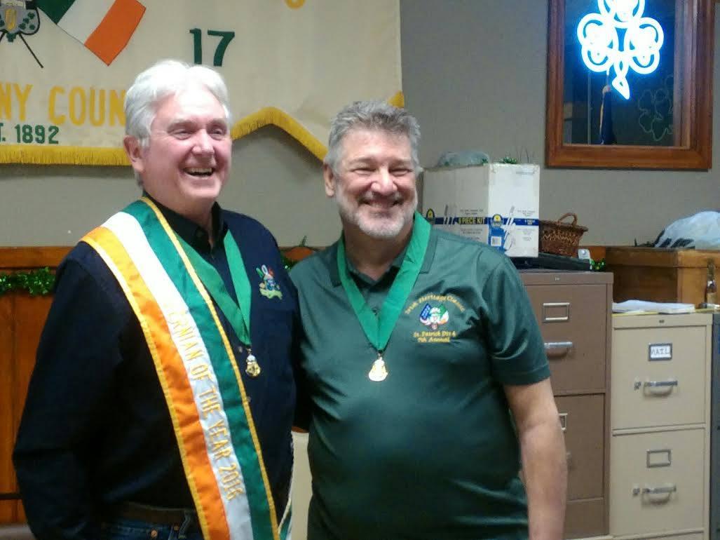 Denny Maher receiving his Hibernian of the Year award from AOH Allegheny County Board President Steve Kurpiewski.