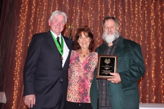 Emcee Denny Maher, Cheryl and Jim Riley