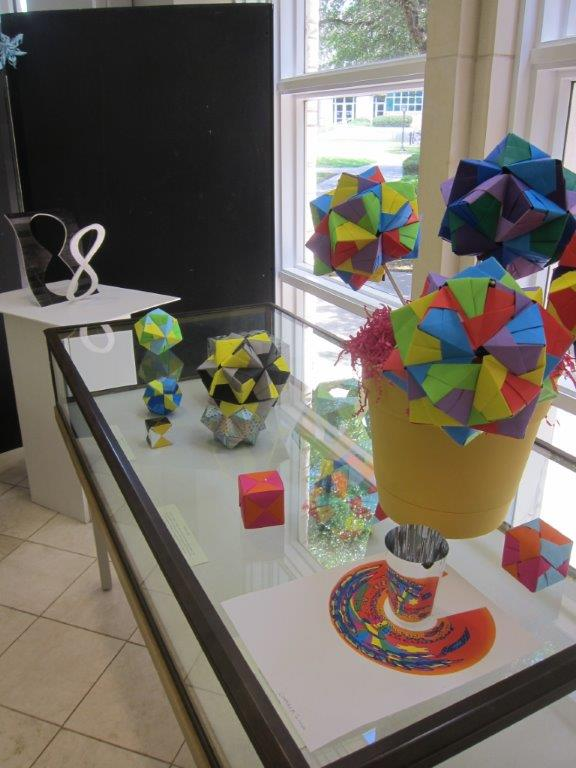 Stellated platonic solid origami, cylinder anamorphisms