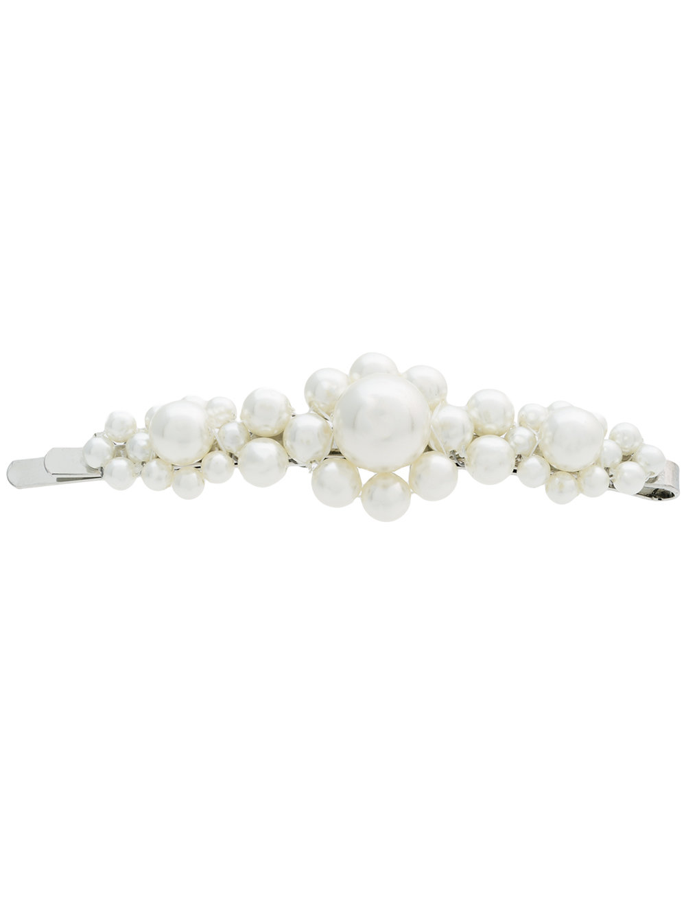 Simone Rocha - This little flower pearl barrette is the best answer to humidity and post-beach hair — I plan on wearing it poolside to tame my wavy hair, or at night with a dress.