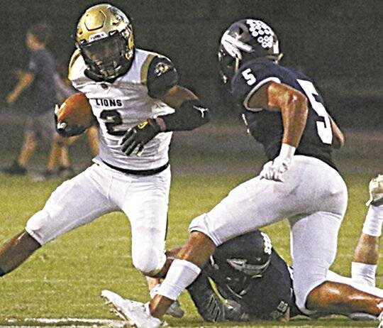 Jordan Jackson   Loganville Christian's Jordan Jackson (2) shakes off the tackle from Nathan Yokley (25) of Brookwood as Mac Brandon (5) gives chase Friday night, Sept. 20, 2019, in Thomasville, Ga.