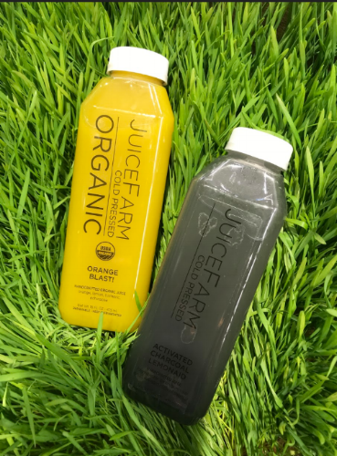 Two juices in a bed of grass