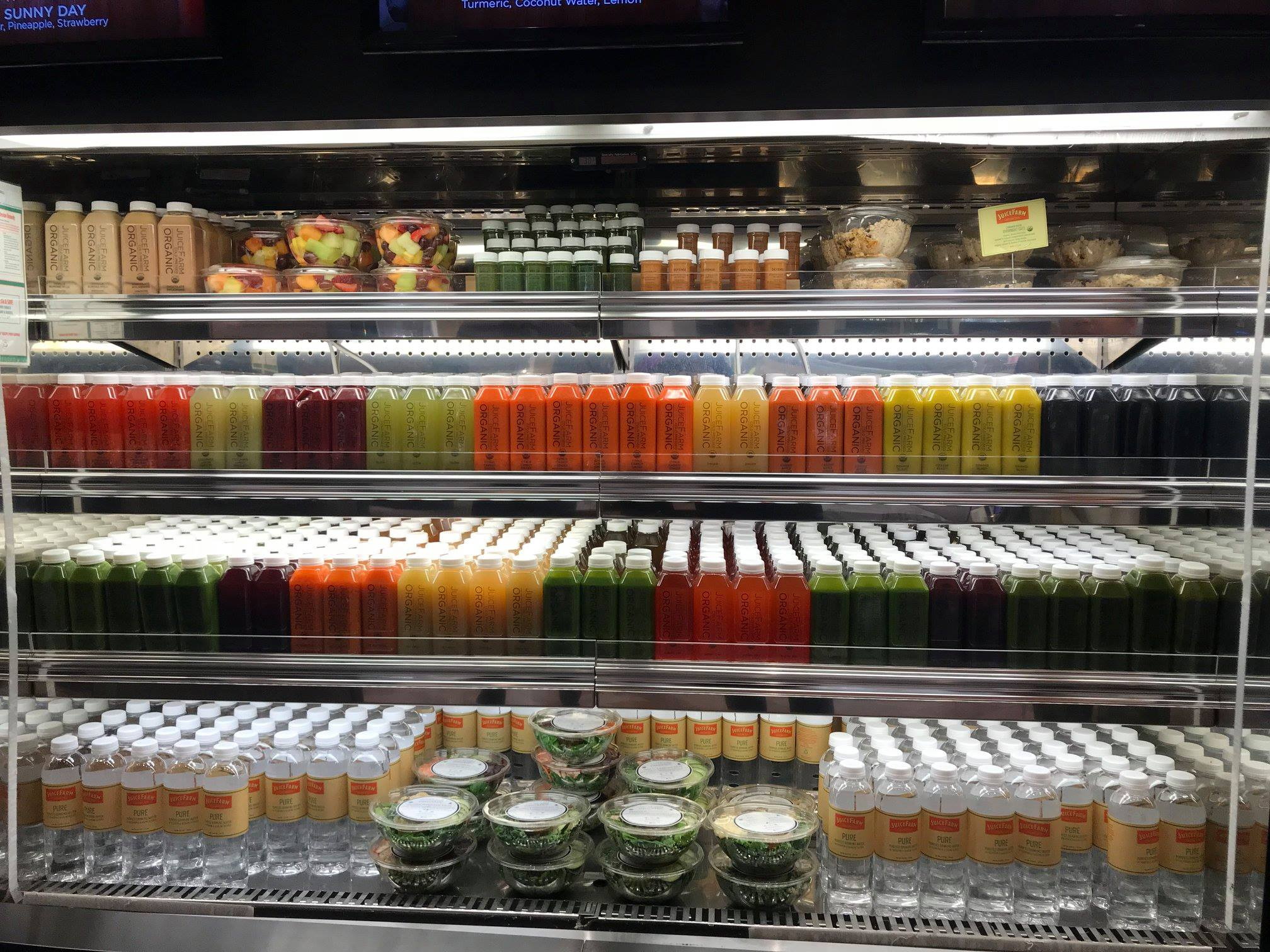 A fridge full of juices and salads