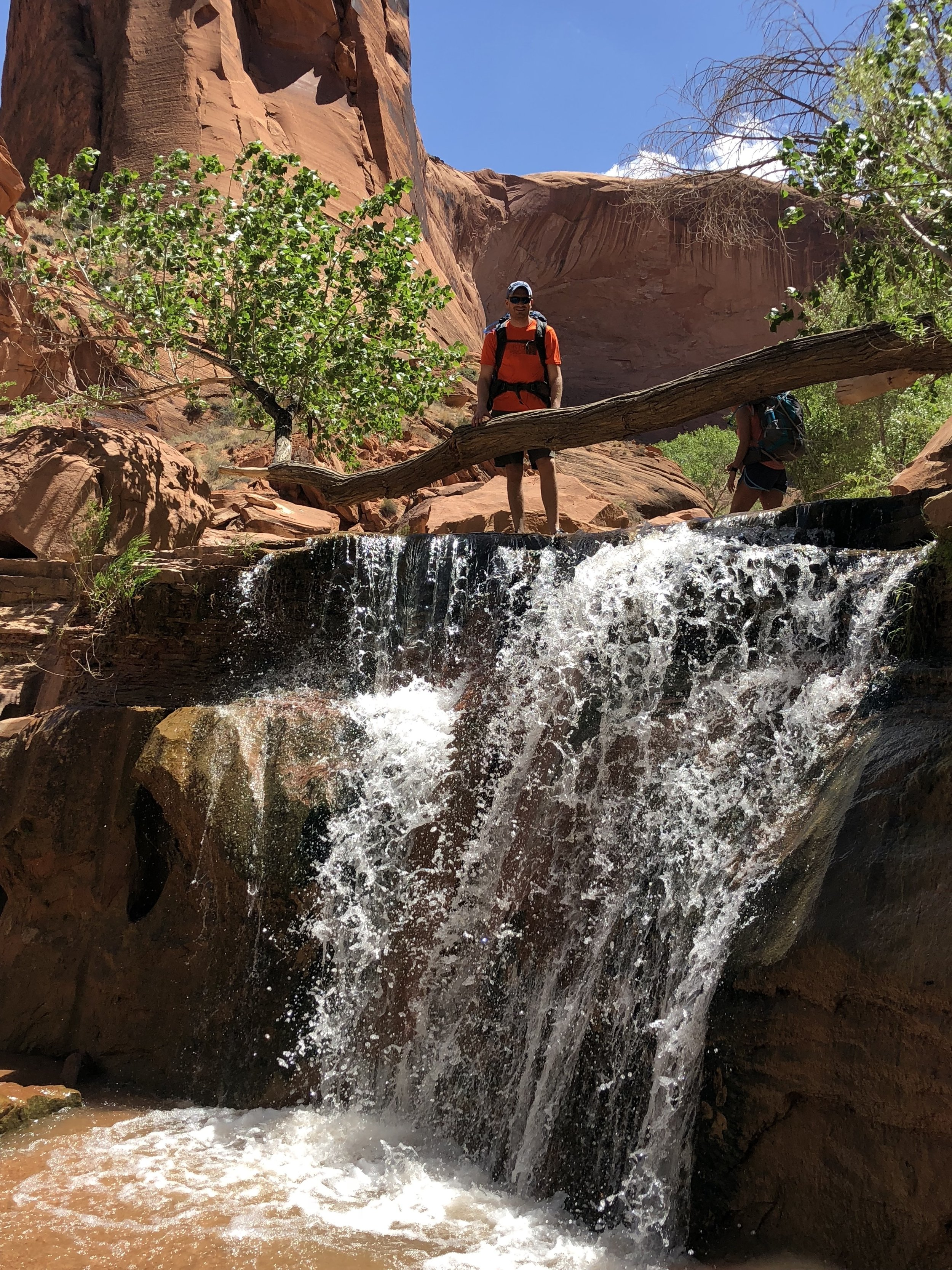 One of the many small waterfalls we encountered with Ben for scale