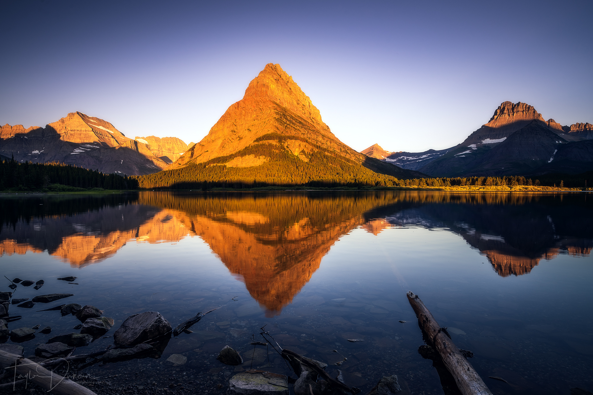 You can witness one of the most beautiful sunrises in the world right from the Many Glacier Hotel