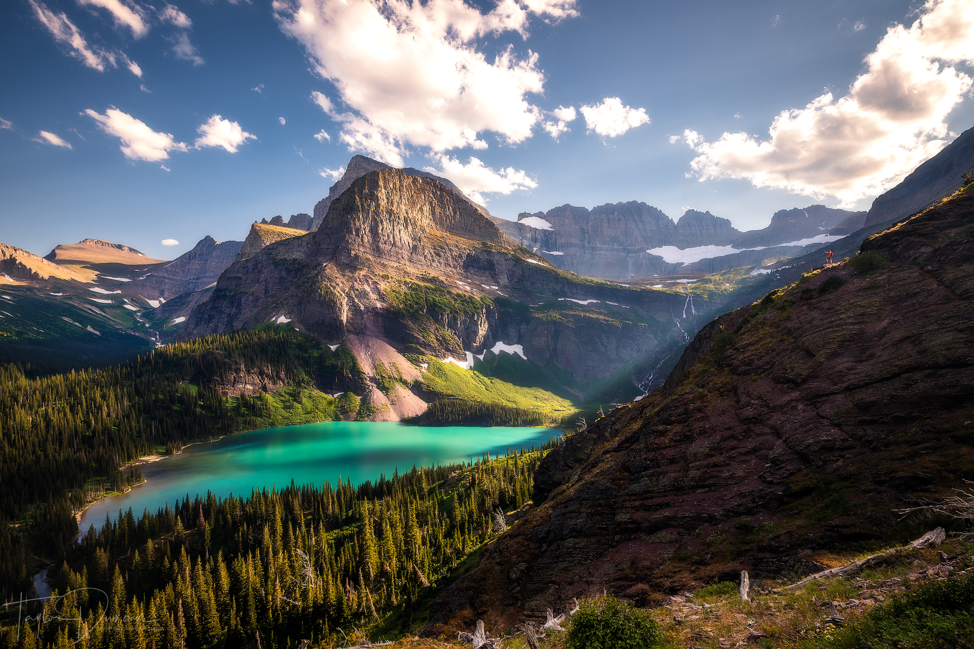 My friend Ben ( @bentretow ) overlooks Grinnell Lake late in the day as shadow starts to overtake the lake