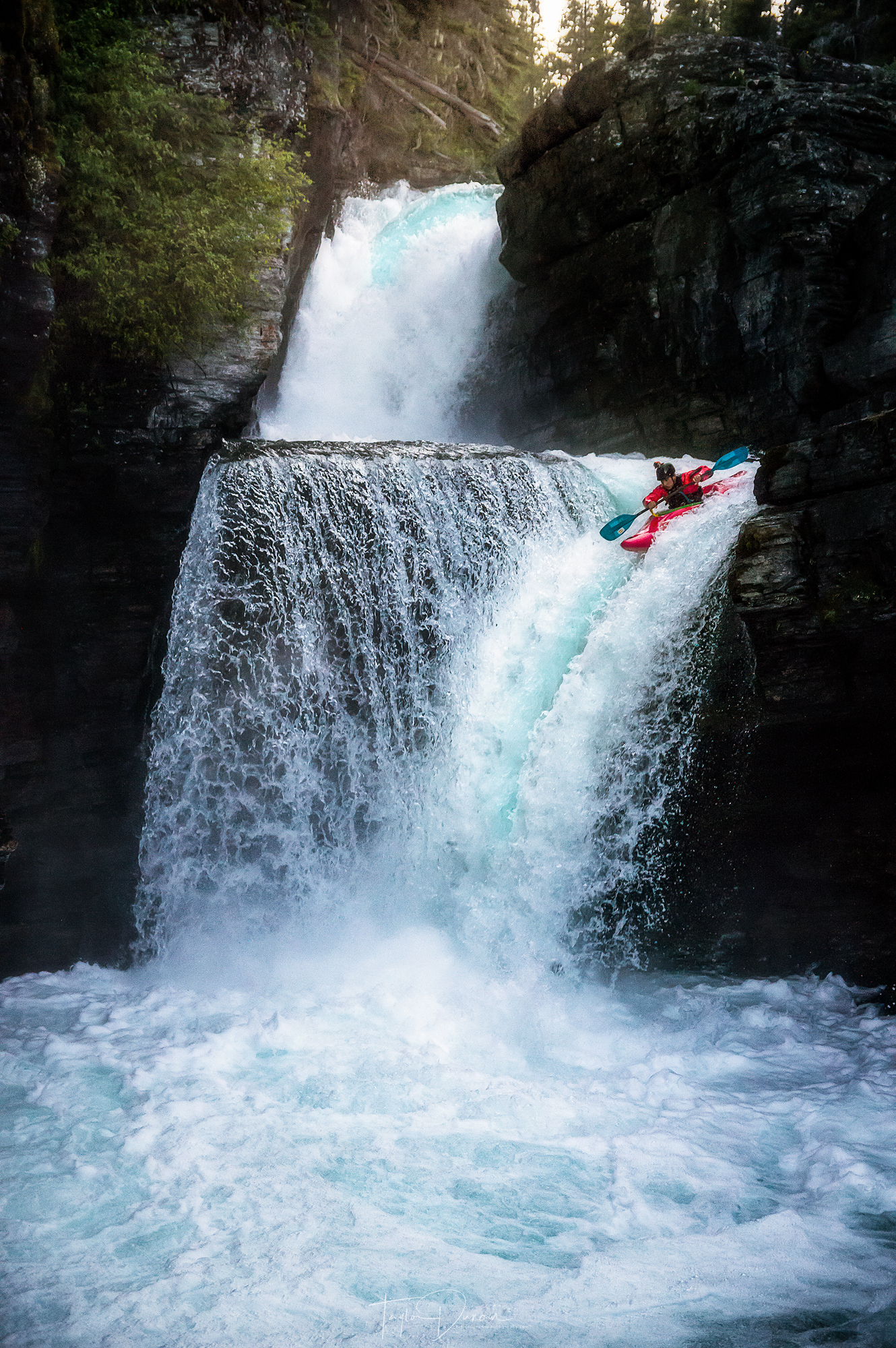 A kayaker paddles off the falls in late June