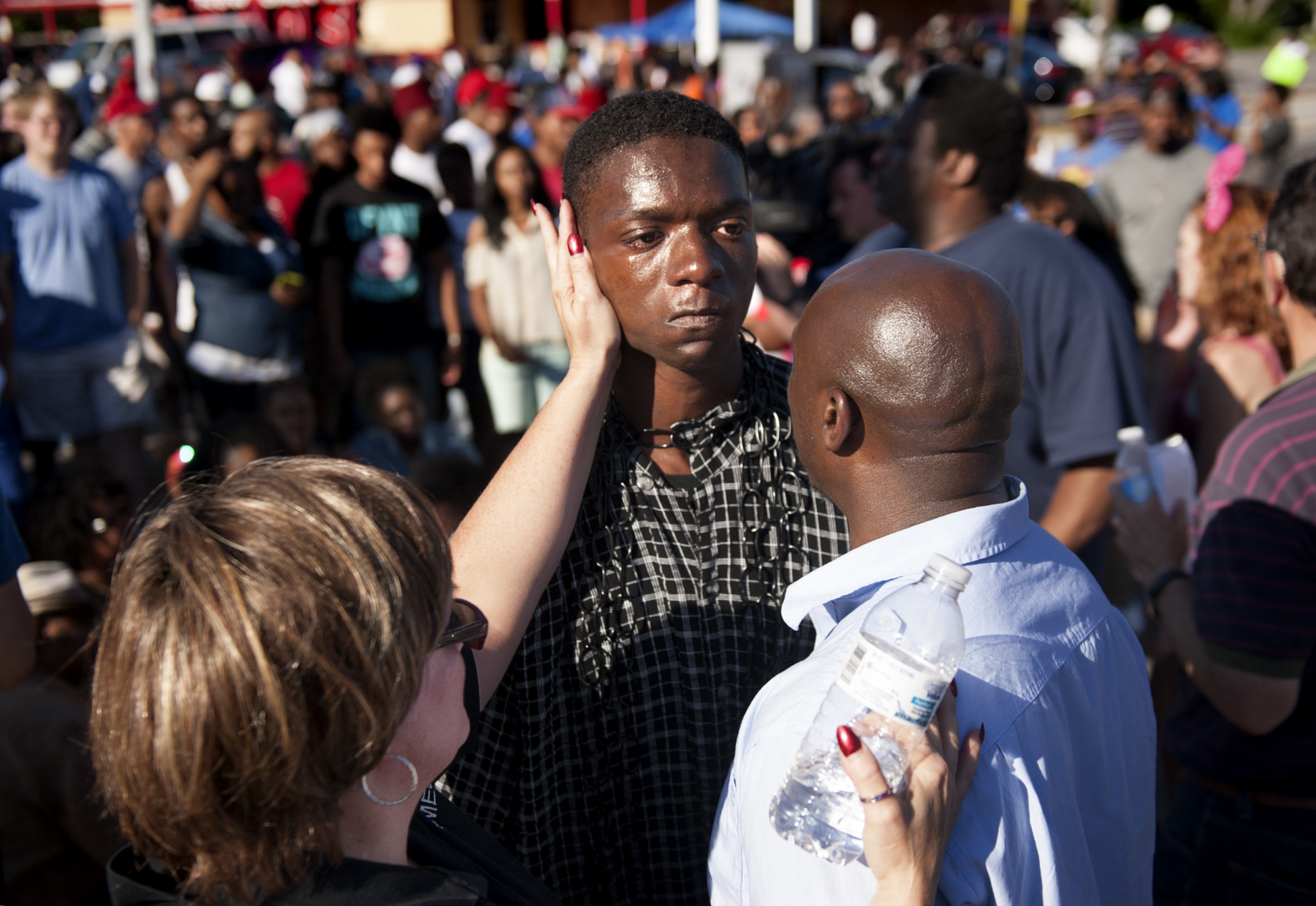 The Rev. Willis Johnson (right) confronts 18-year-old Joshua Wilson as protesters defy police and block traffic on West Florissant Avenue at Canfield Drive in Ferguson, Mo. Wednesday, Aug. 13, 2014 as part of their protests over the the shooting of 18-year-old Michael Brown, Jr., who died Saturday, Aug. 9, 2014 following an altercation with police in the St. Louis suburb. Rev. Johnson convinced Wilson, one of the last holdouts in the intersection, that he should leave and avoid arrest. Joining Johnson and Wilson was a member of the clergy from the African Episcopal Methodist Church who declined to give her name. (Photo by Sid Hastings/For The Washington Post via Getty Images)