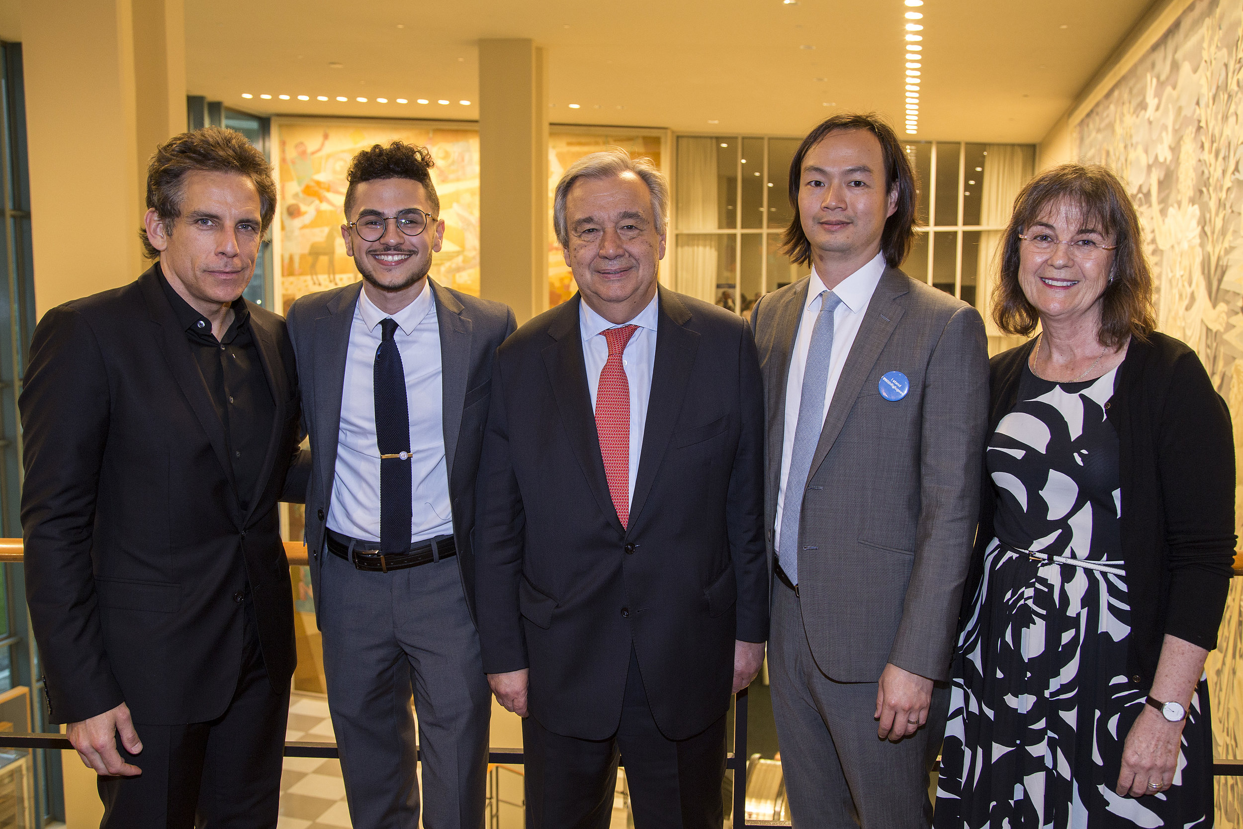 """For World Refugee Day 2017, Ahmed read his poem,  """"A Thank You Letter From the Bomb that visited My Home""""  at a private United Nations reception. From left to right: Ben Stiller, Ahmed, UN Secretary General Antonio Guterres, Christopher Tin, and UNHCR NY Director Ninette Kelly. (Scott Nelson)"""