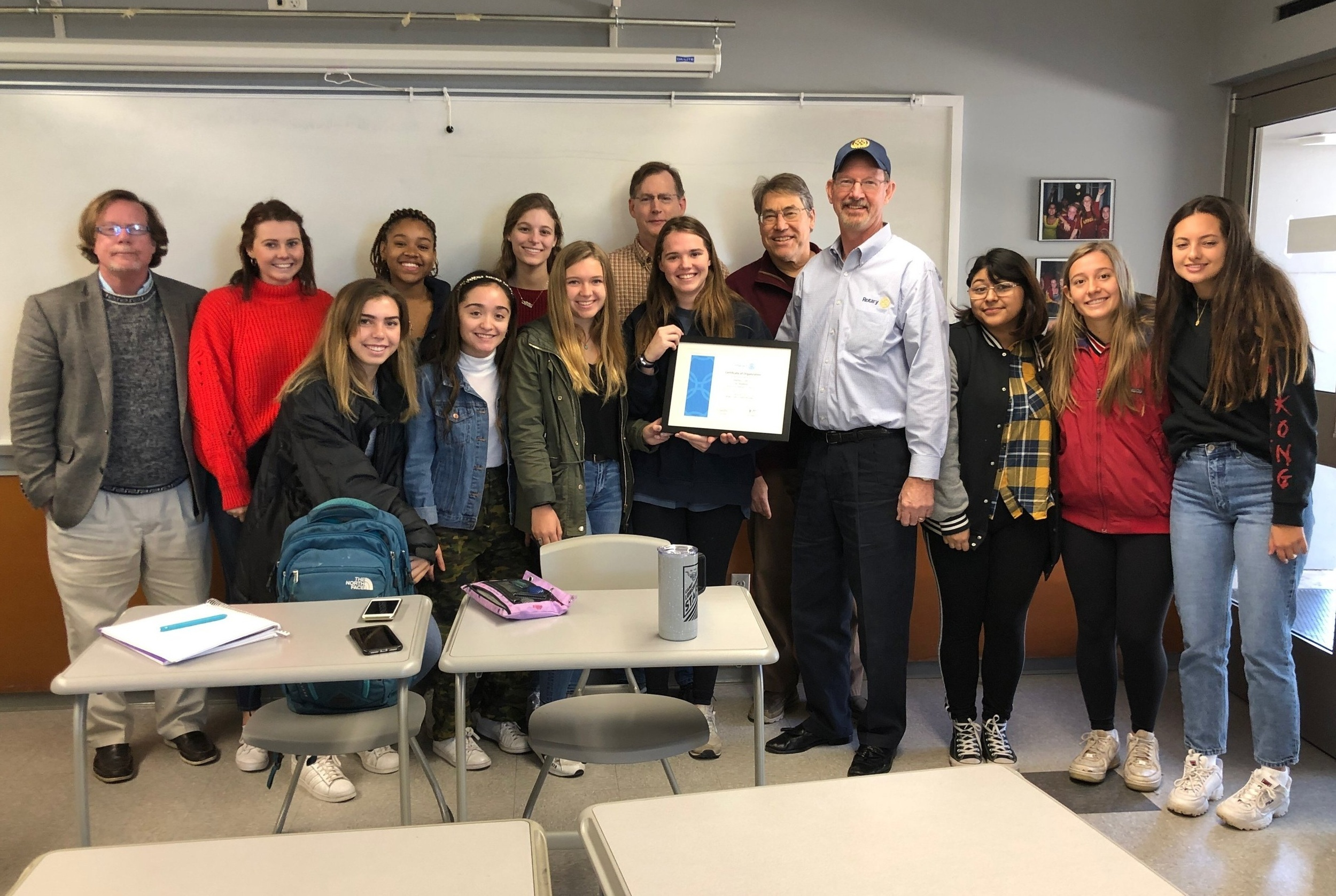 Westlake Rotary presents the newly formed St. Stephens Interact Club with their charter.