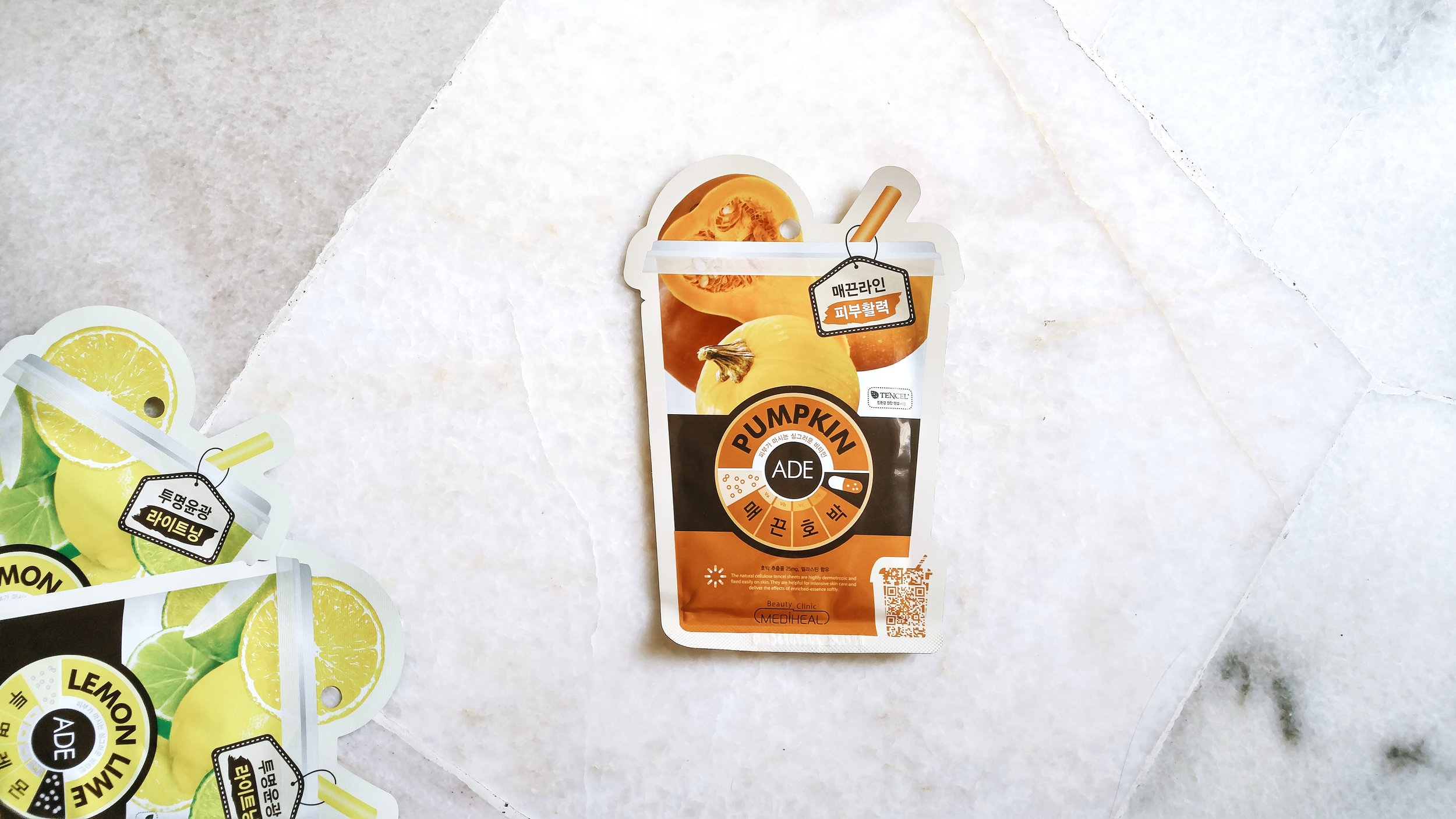 Mediheal Pumpkin Ade Mask. also in frame, the Lemon Lime Ade Mask from the same range. how cute is this cup-with-straw packaging?