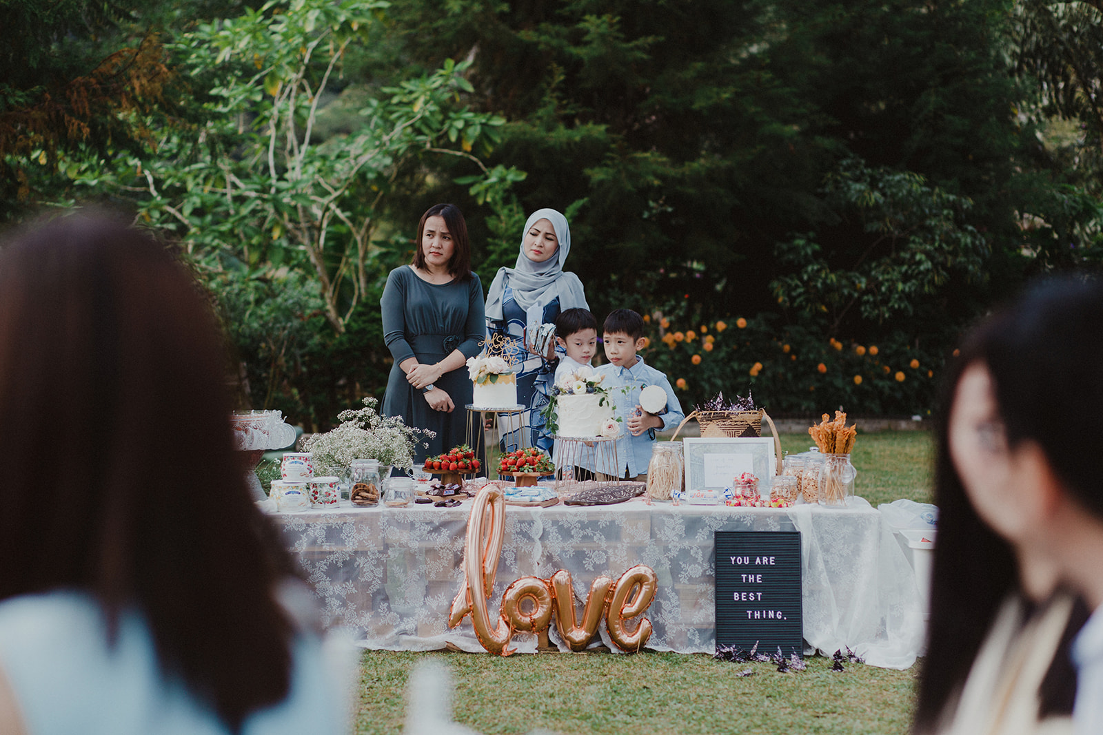 a casual dessert/snack table setup. topped with our favorite childhood snacks, local fresh strawberries, etc. it was a hit with our guests :)