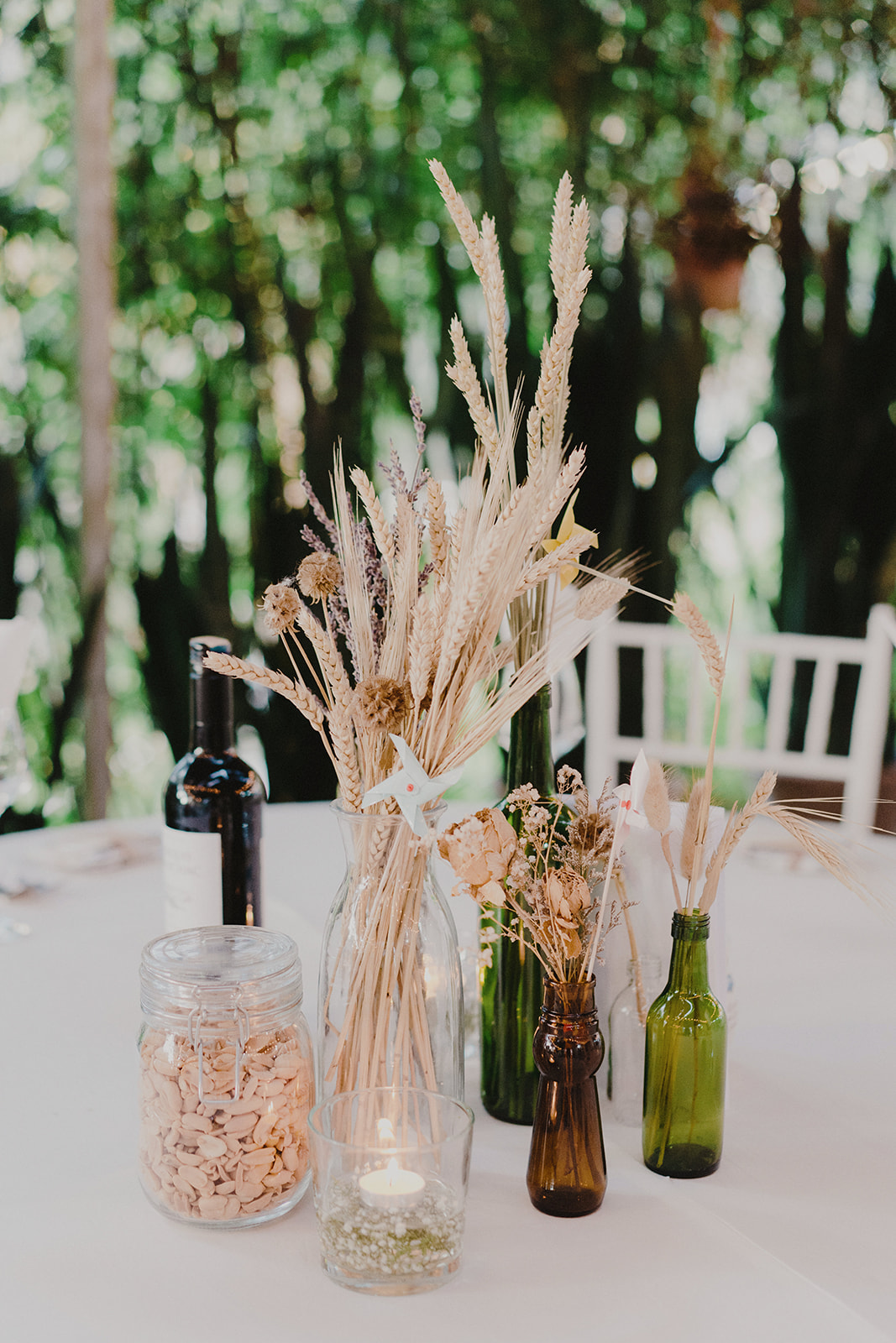 i have a huge collection of glass jars over the years (couldn't help but to keep all of it) and the jars became super useful for our table centerpieces. we filled them up with some dried flowers, nuts, tealight candles..