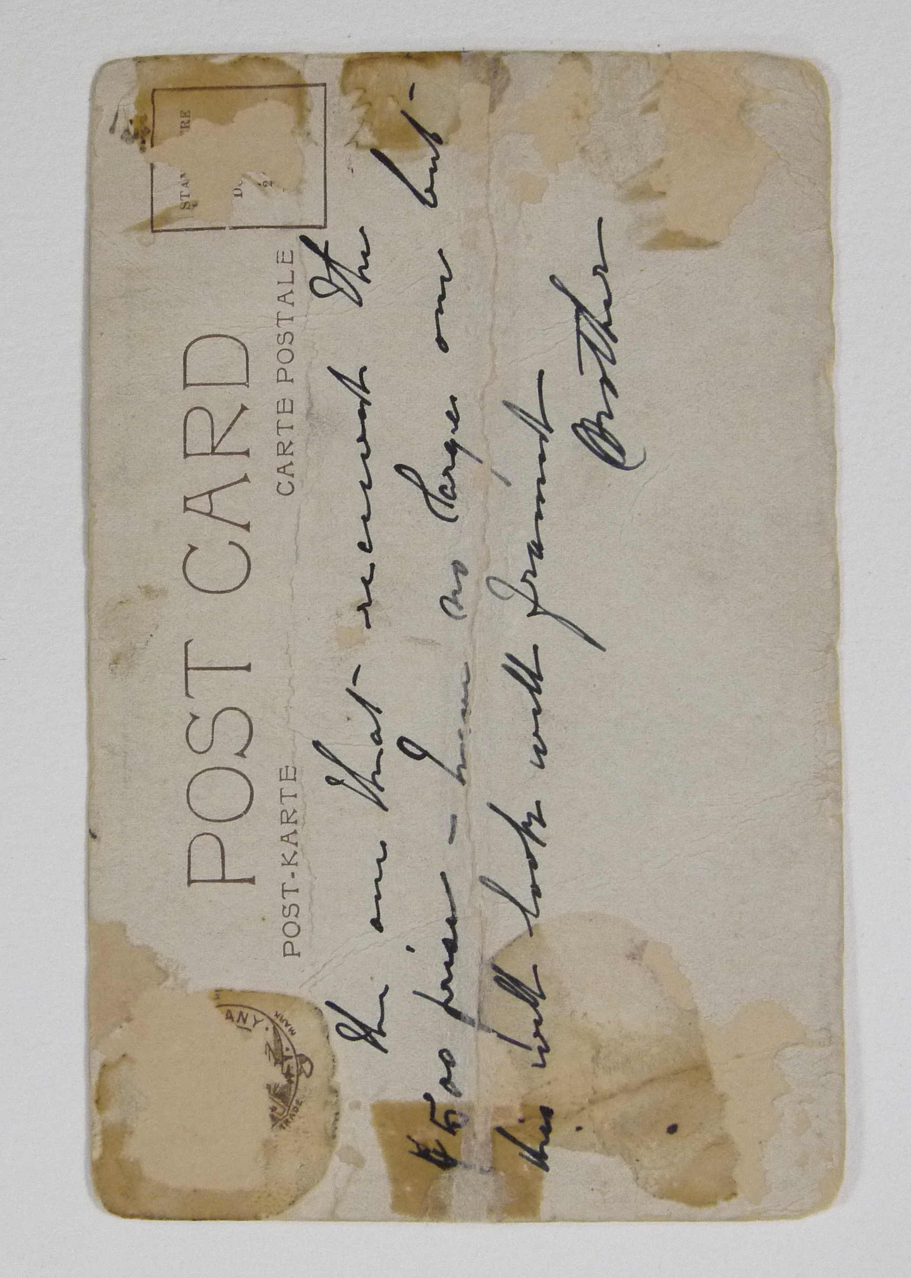 Verso of the postcard after conservation treatment.
