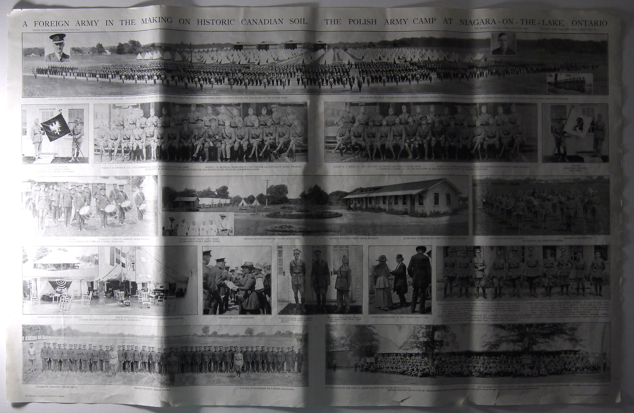 The large illustrated newspaper sheet in raking light, showing vertical ripples.