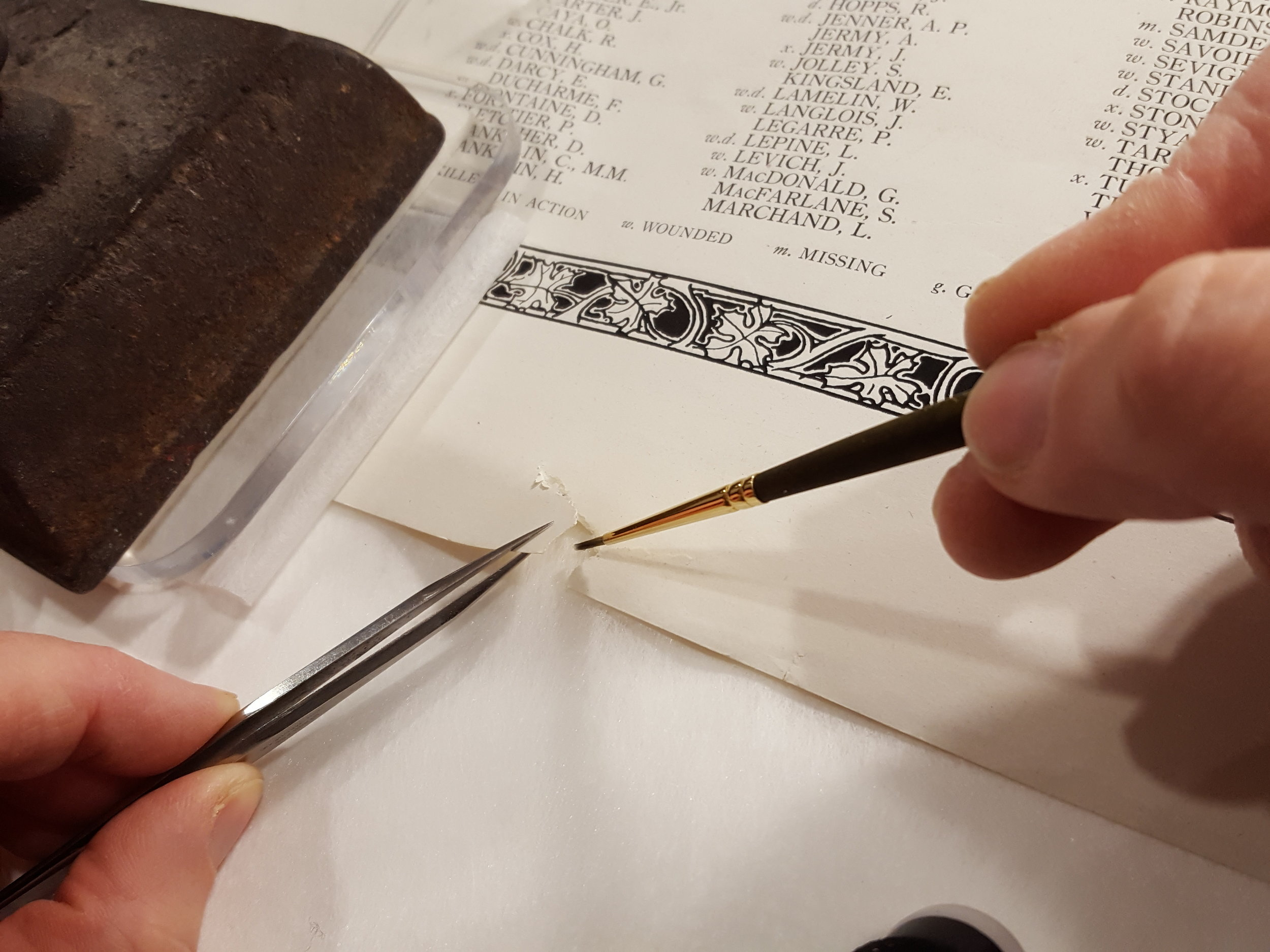 Repairing a tear in the margin with wheat starch paste and Japanese tissue.