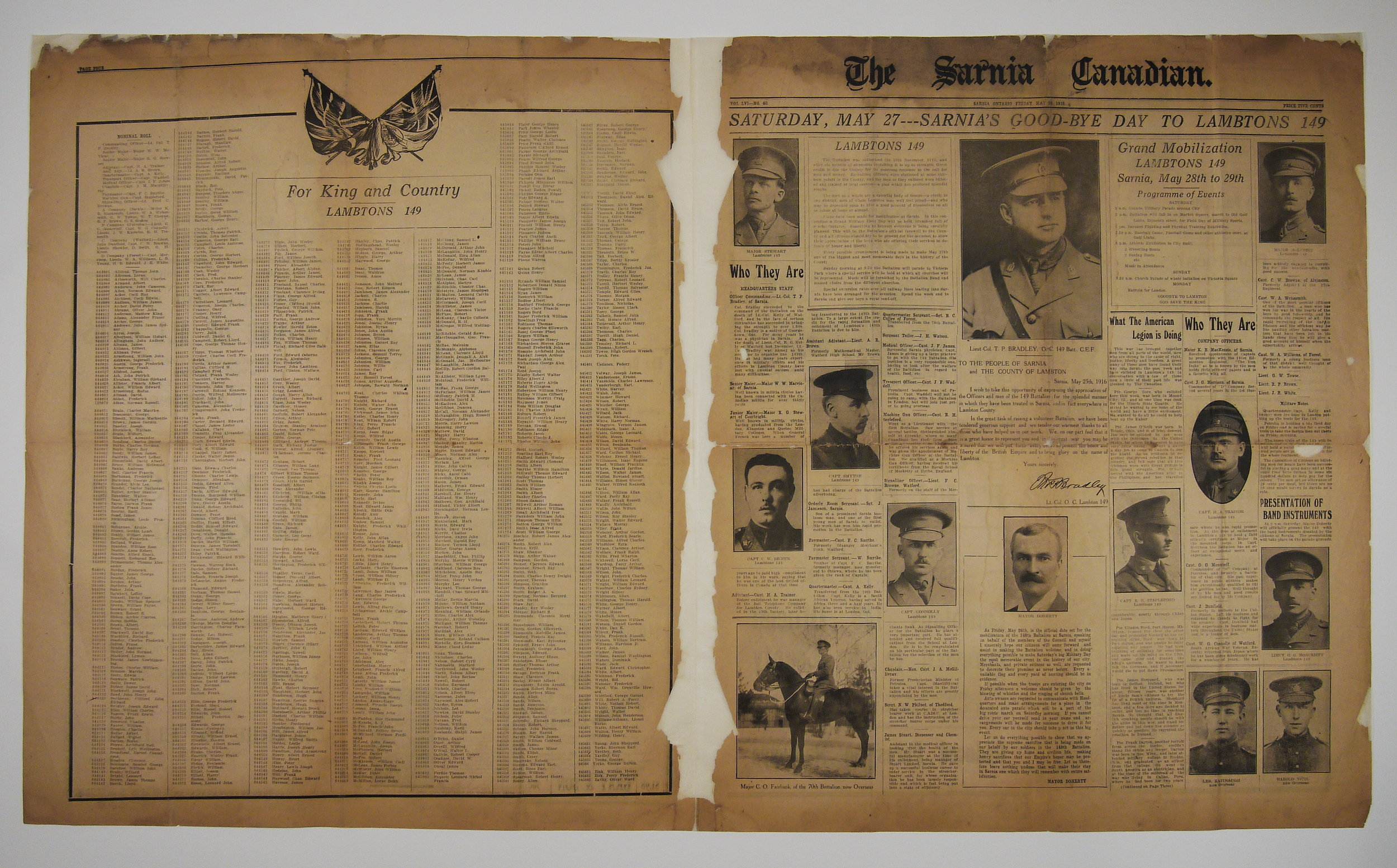 The newspaper spread after repair and restoration.