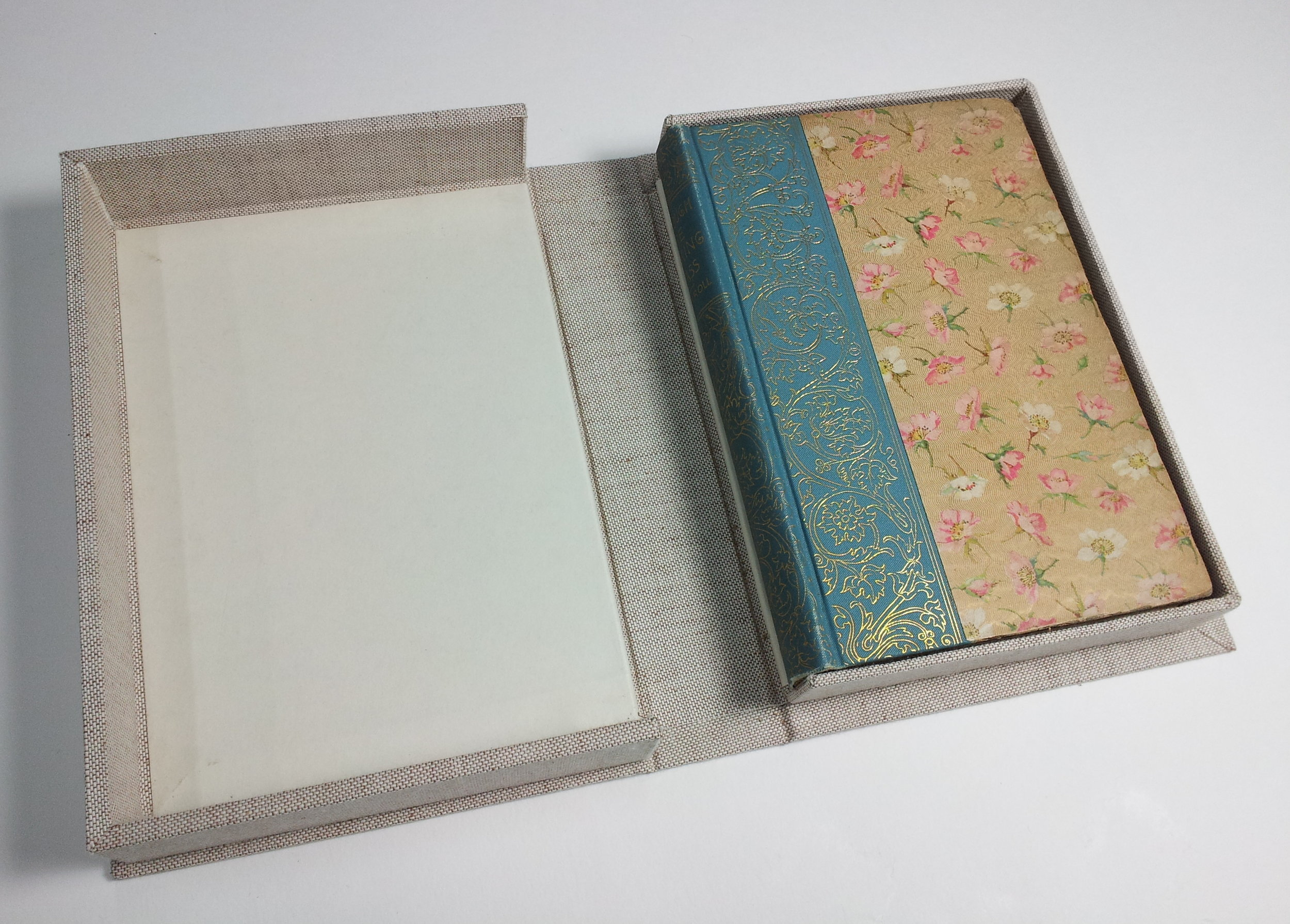 A conservation clamshell with plainer materials protects the book from dust and light.