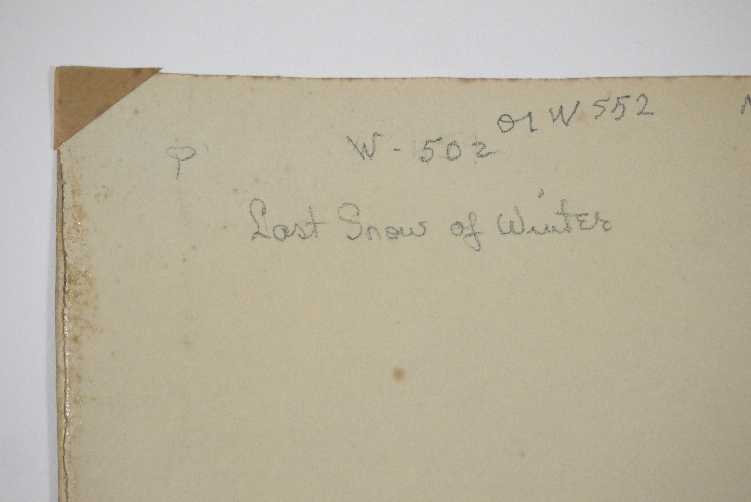 Verso of  Last Snow of Winter , showing tape and adhesive residue, before conservation treatment.