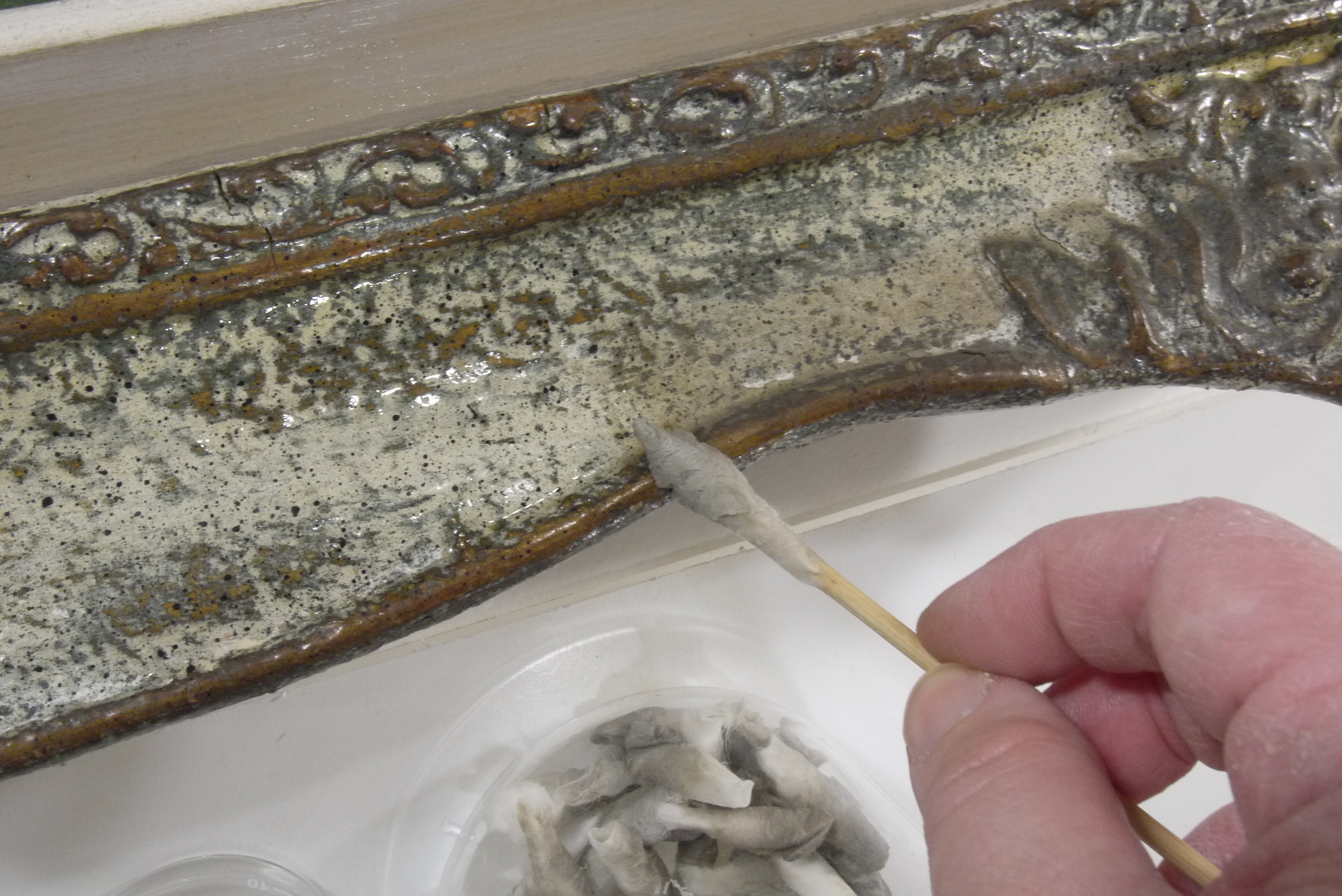 Cleaning surface dirt and grime off the original frames.