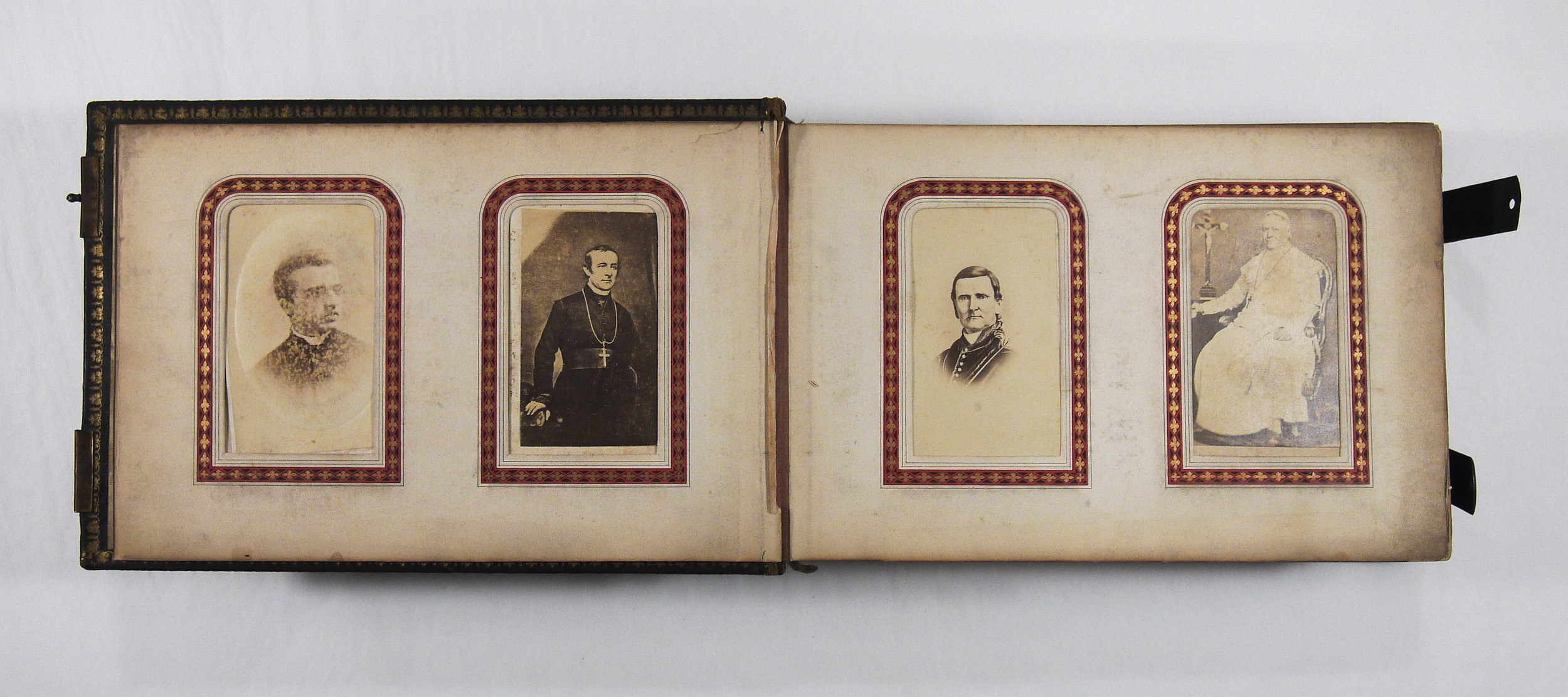Bishop Crinnon carte de visite album, showing a spread of pages featuring portraits of clergy.