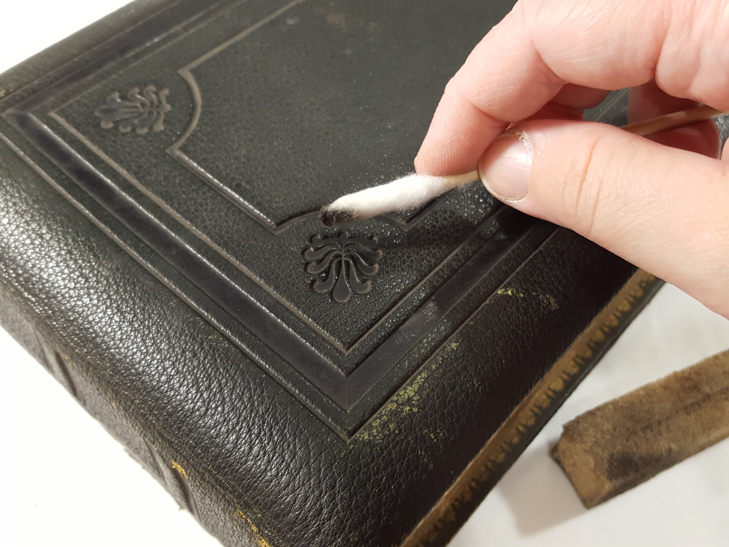 The binding was cleaned to remove surface grime.