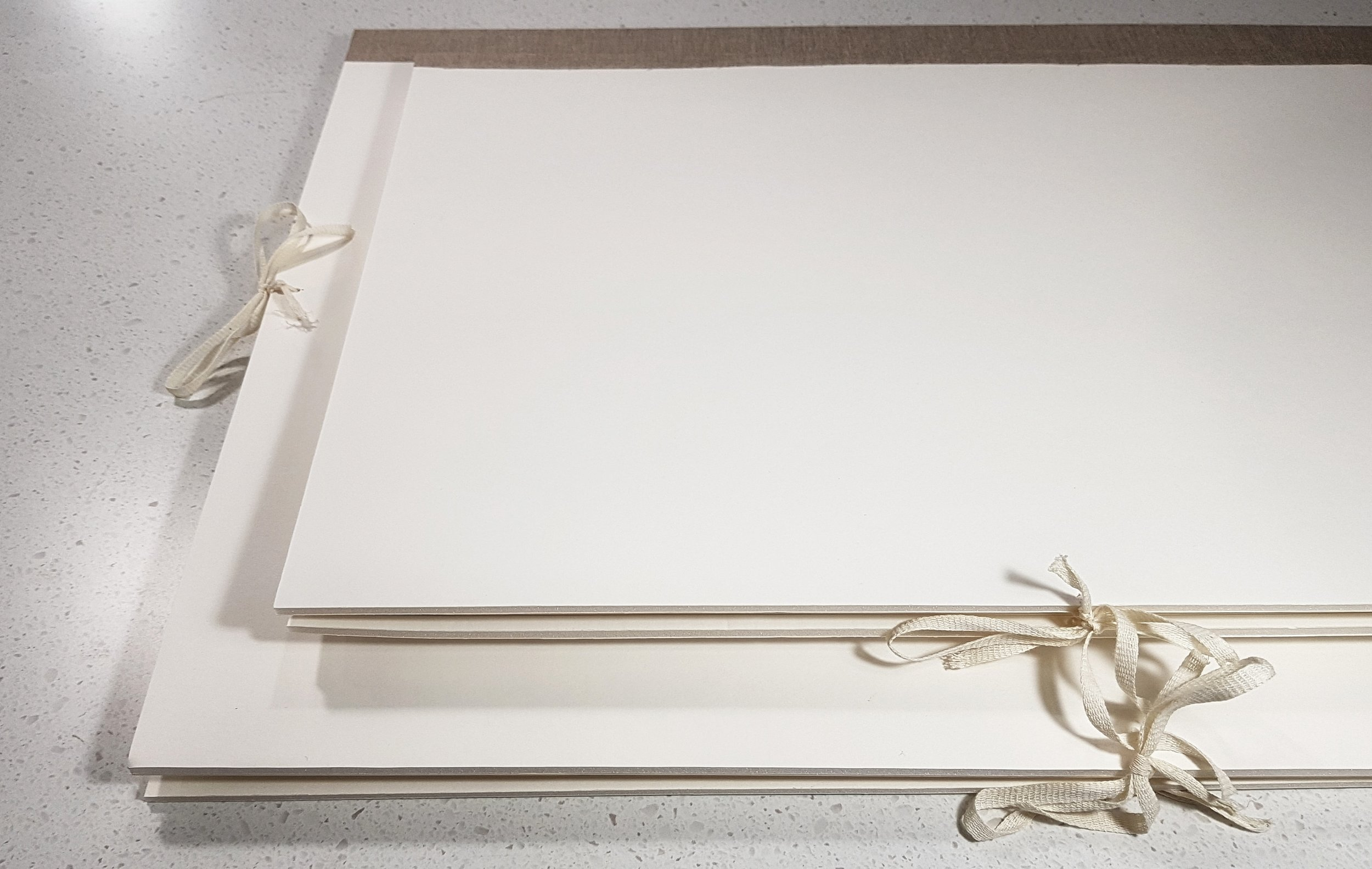 Custom acid-free storage folders, to protect paper artifacts in long-term storage.
