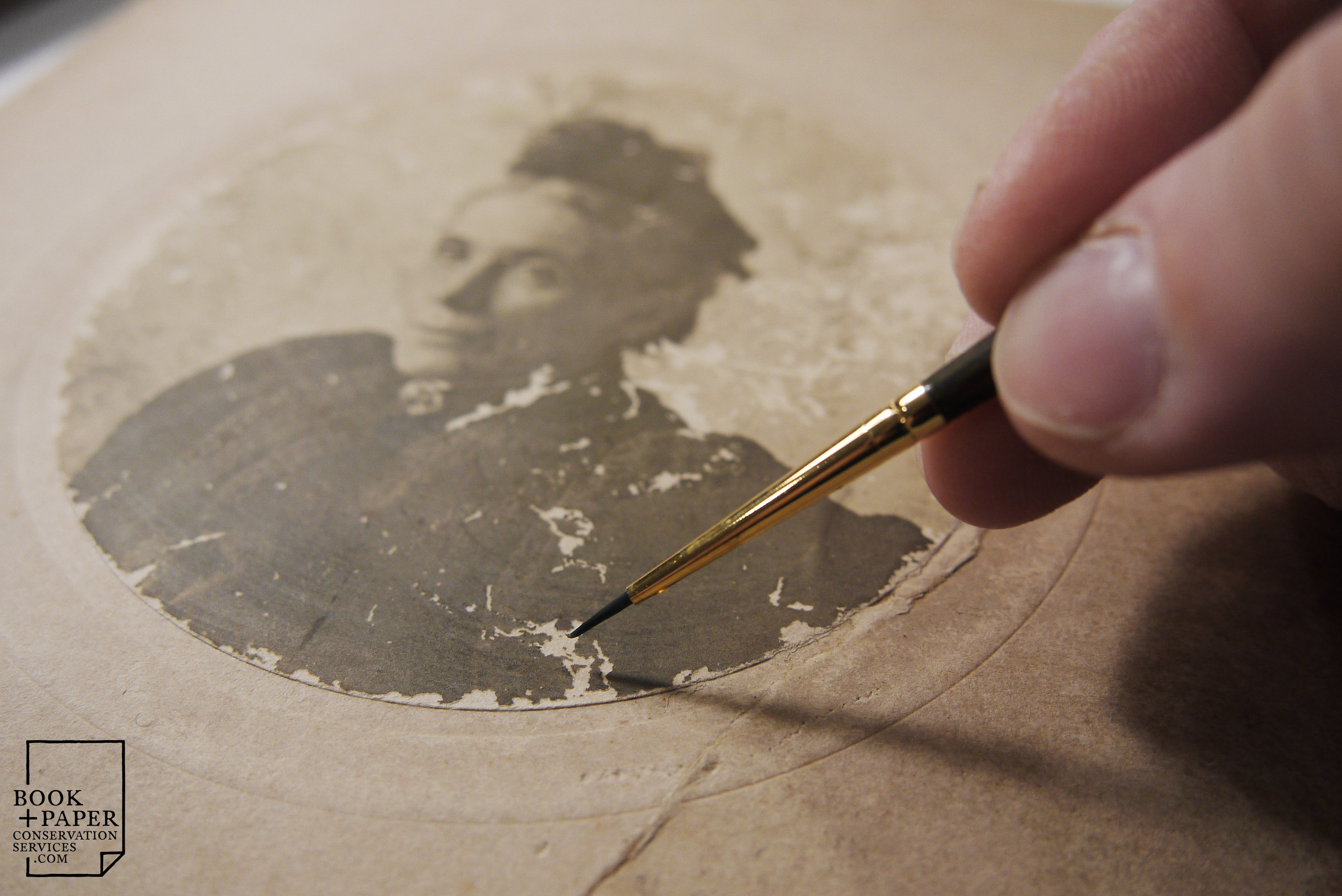 Inpainting losses to the emulsion layer of a 19th century photograph.