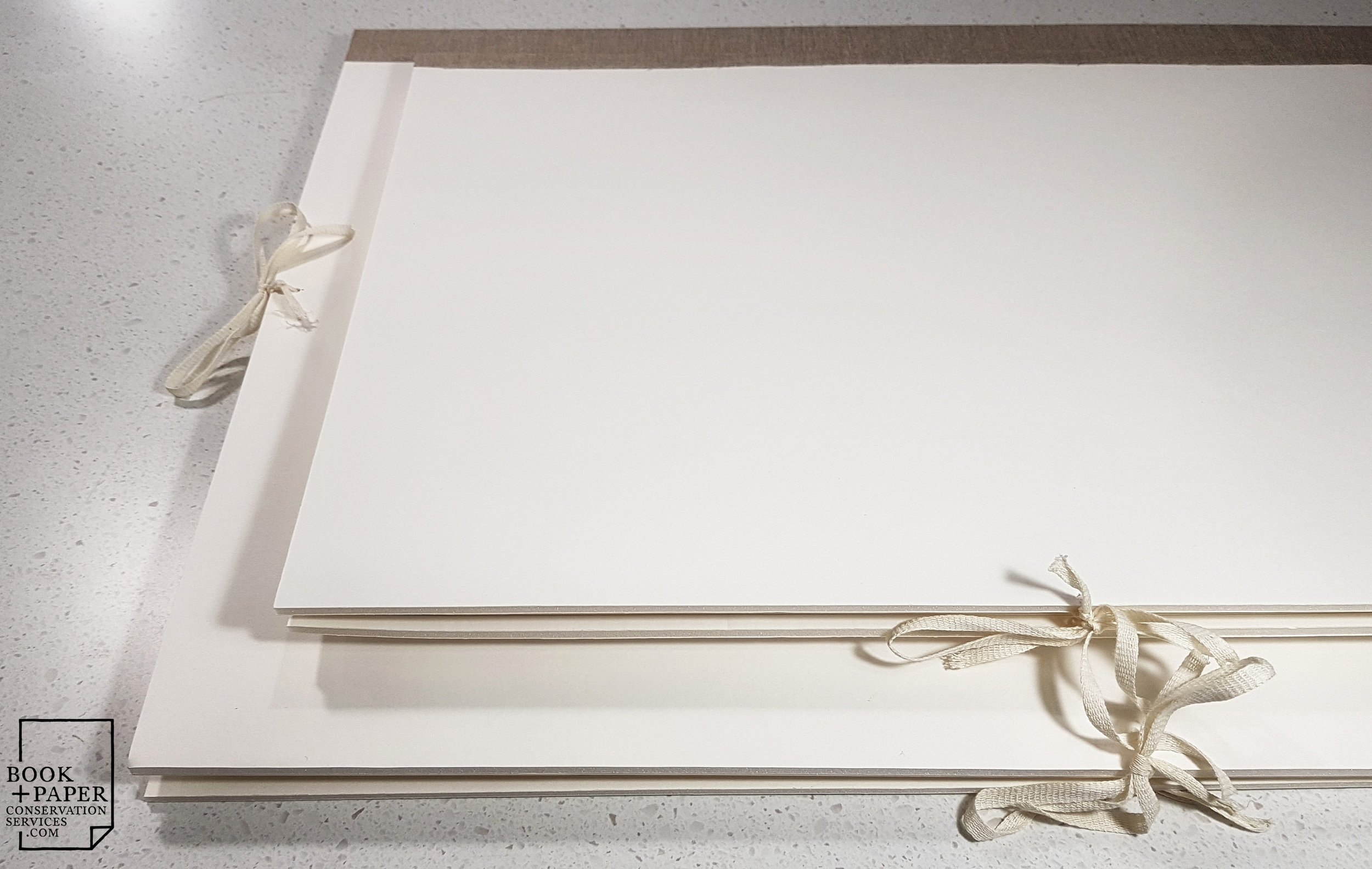 Custom archival storage folders made to house family history documents once they have been conserved at our studio.