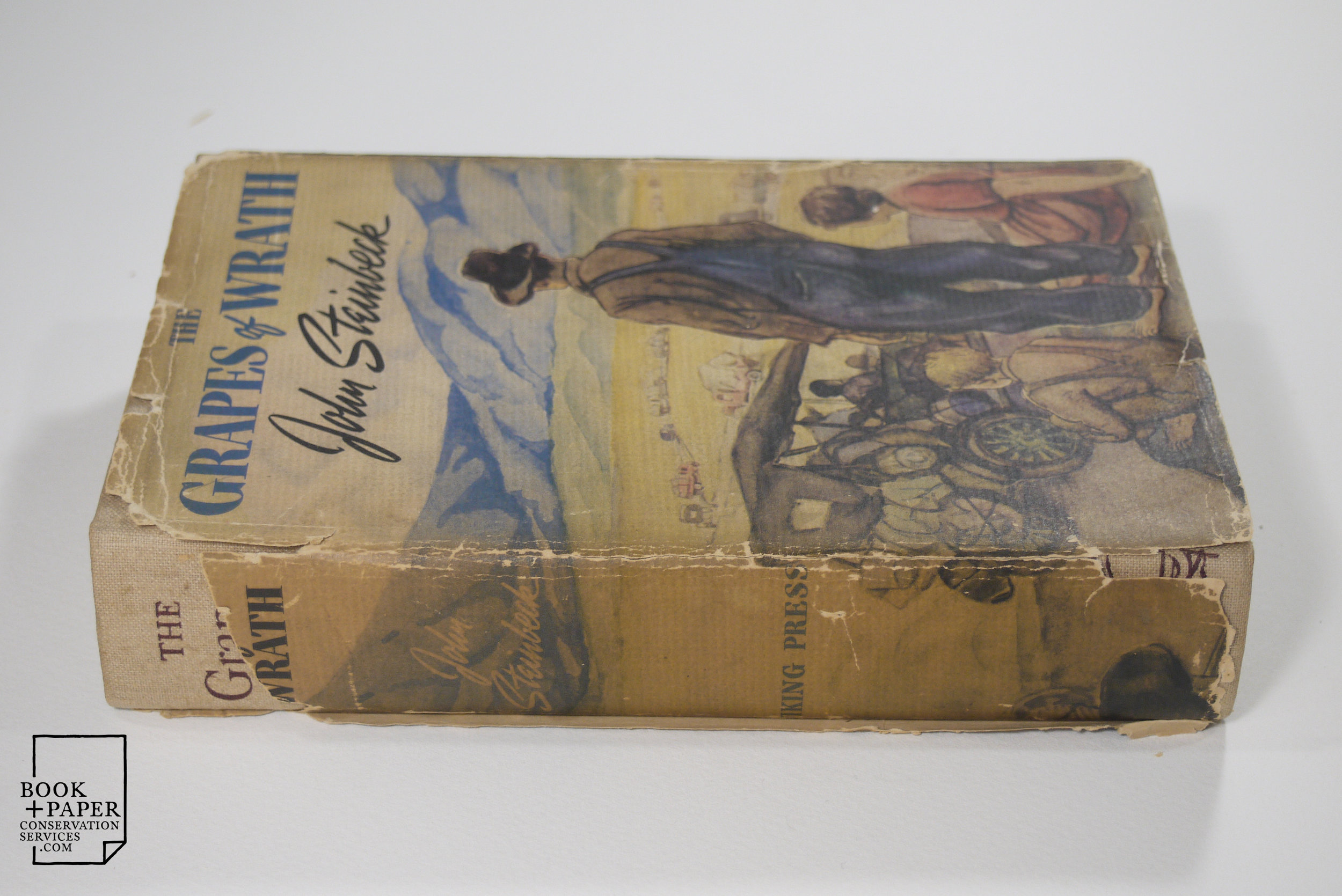 The Grapes of Wrath, 1st edition, front cover and spine before restoration.