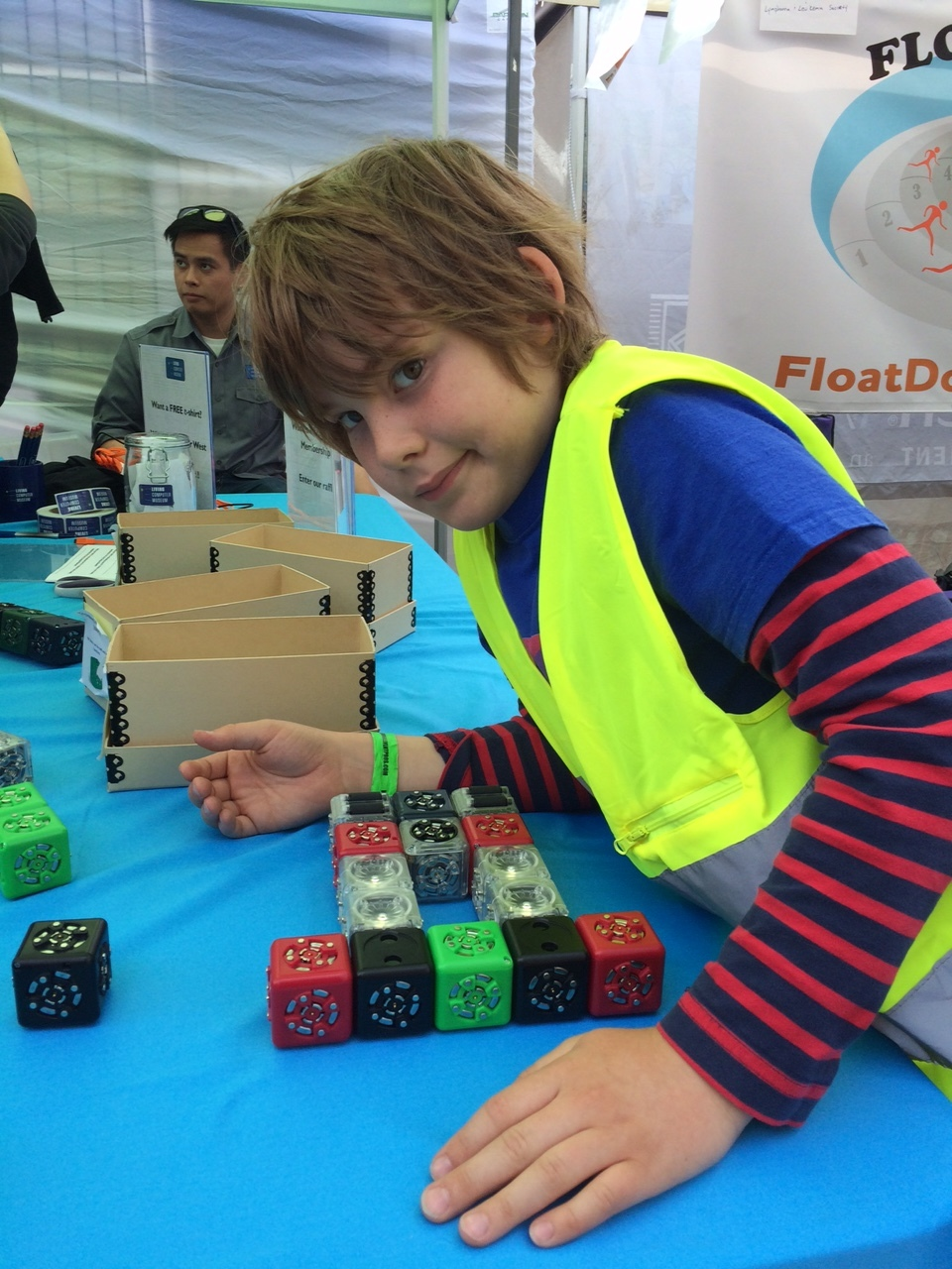 Testing out the cubes at Living Computer Museum booth at the 2016 West Seattle Summer Festival.