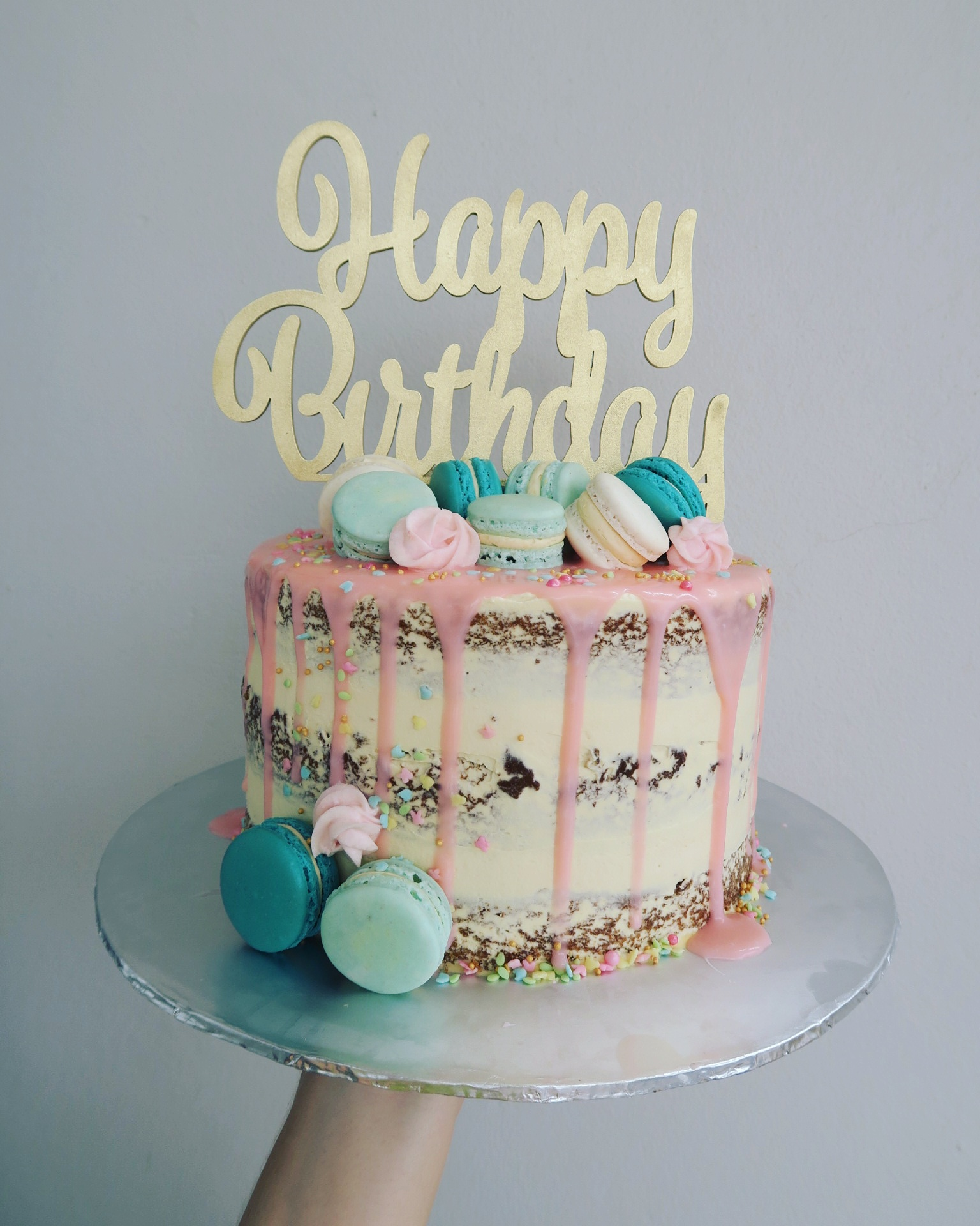 Drips & Macs naked cake with wooden topper.jpg