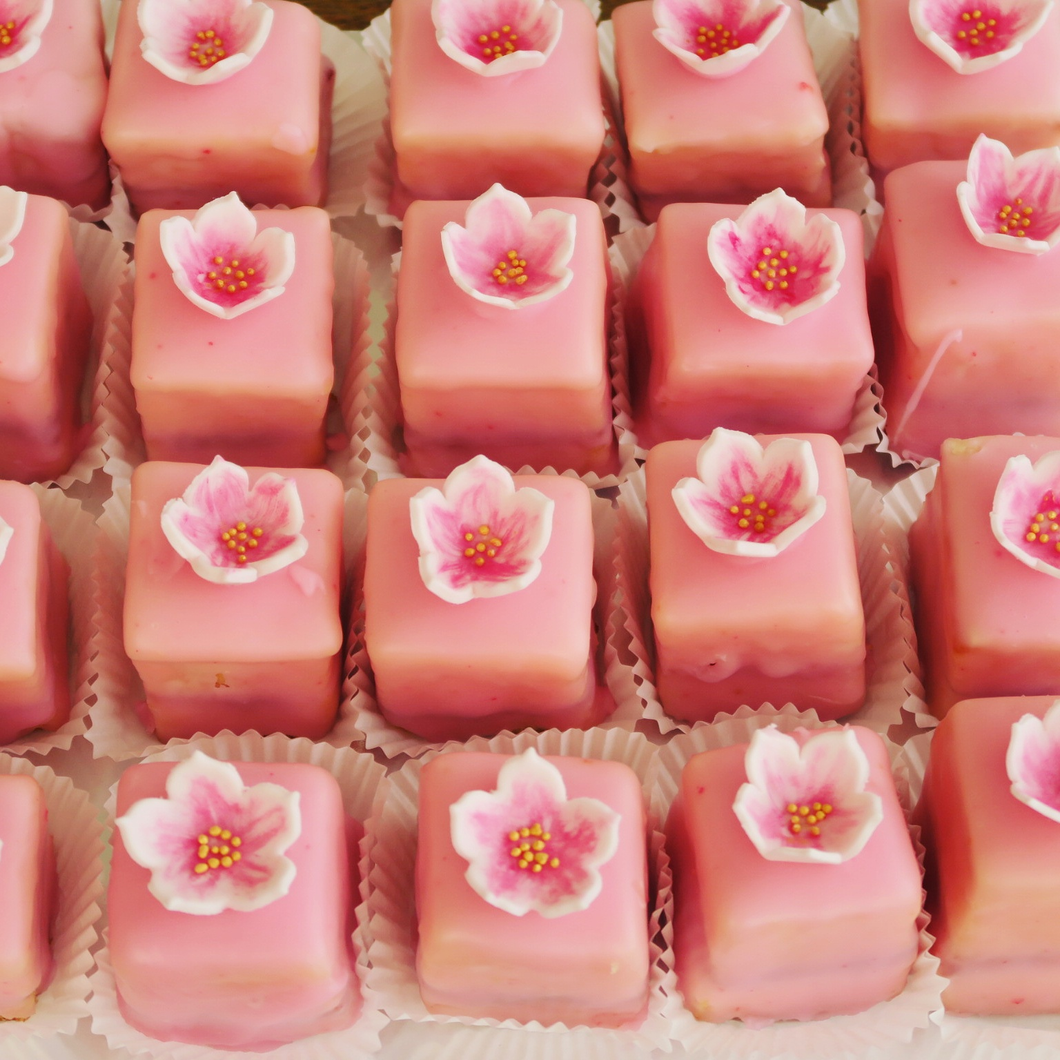 Petit fours with handmade flowers.jpg