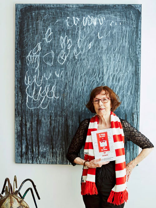 Jan with one of the artworks in her collection, as seen in the interview.