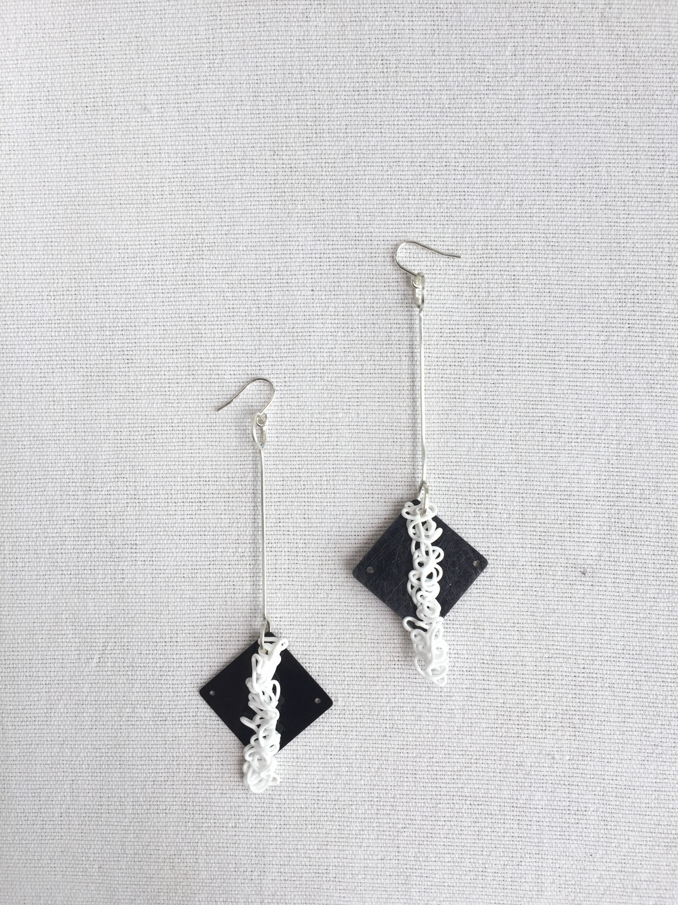 diamond squiggle earrings.jpg