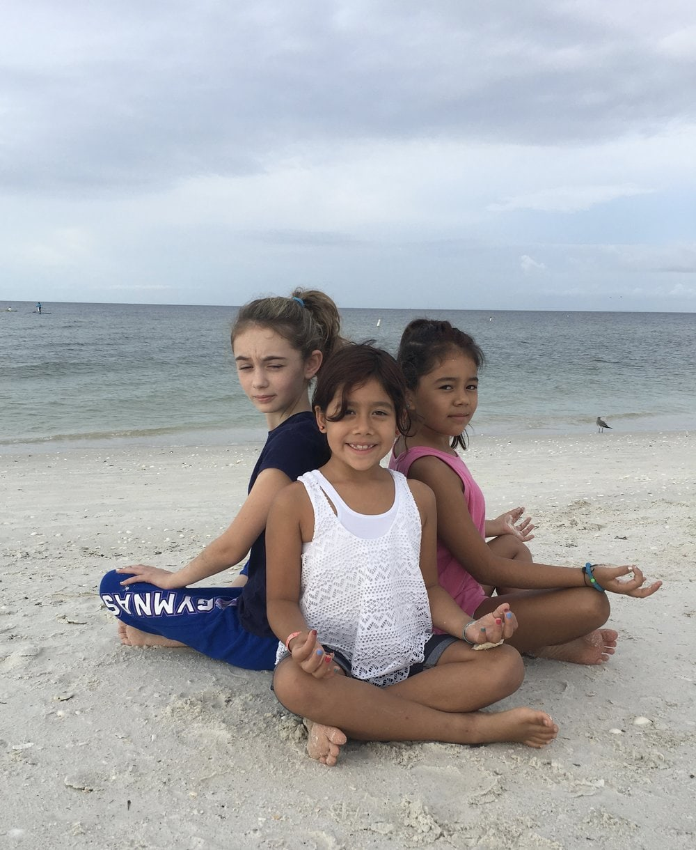 Friends Eating Oyster Pose from the book Breathe and Stretch on the Beach.