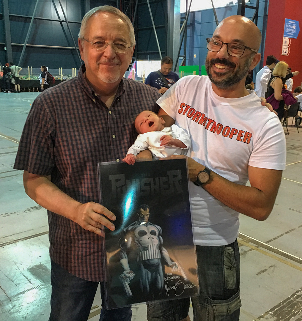 "Alejandro now holds the record for ""my youngest fan""!! At only 15 days old, he came by my table to choose his first art print ever... the Punisher. Thank you Alejandro!"