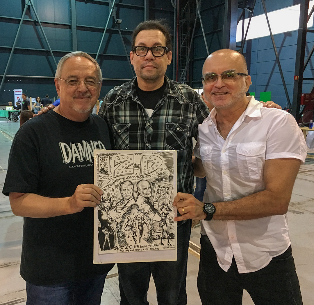 "Met Mike Deodato for the first time at our first dinner after arriving in Gijón. In a matter of minutes, the adventure team of ""Z and D"" was born thanks to Rodney Ramos, Will Conrad, and our other dinner companions. And later during the show, Rodney Ramos presented us with the cover art for our origin book. Z and D... ""Just 2 guys trying to draw the line..."""
