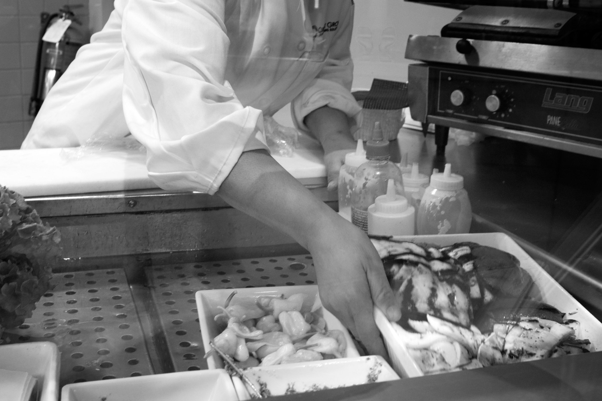 Evelyn at work in a corporate cafe several months before her promotion to sous chef. New York City (2014)
