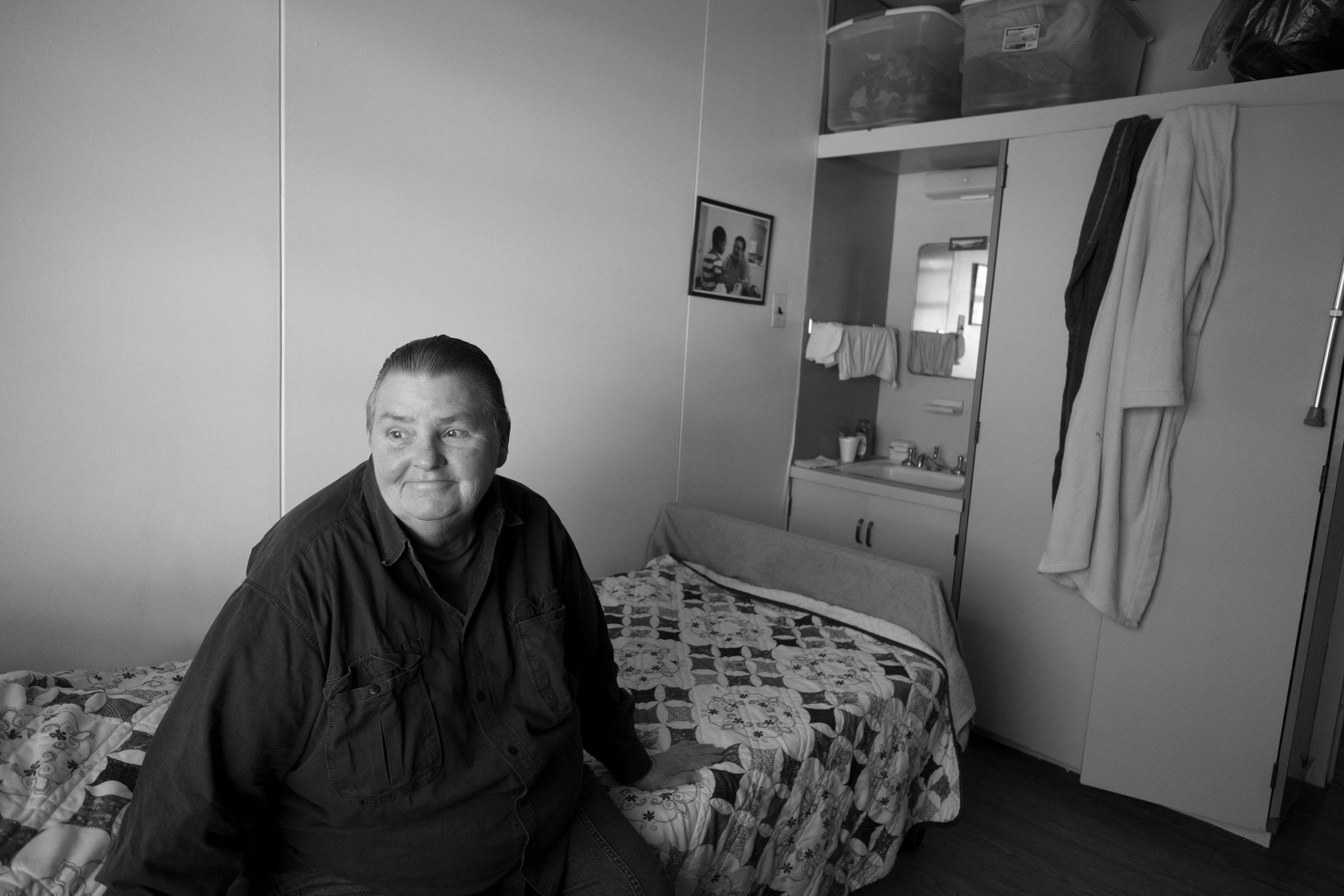 Carol in her bedroom. Long Island City, NY (2017)