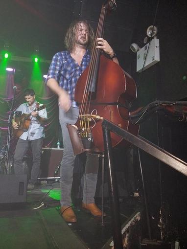 Ricky B plays the upright bass photo by Sandi Atkinson.