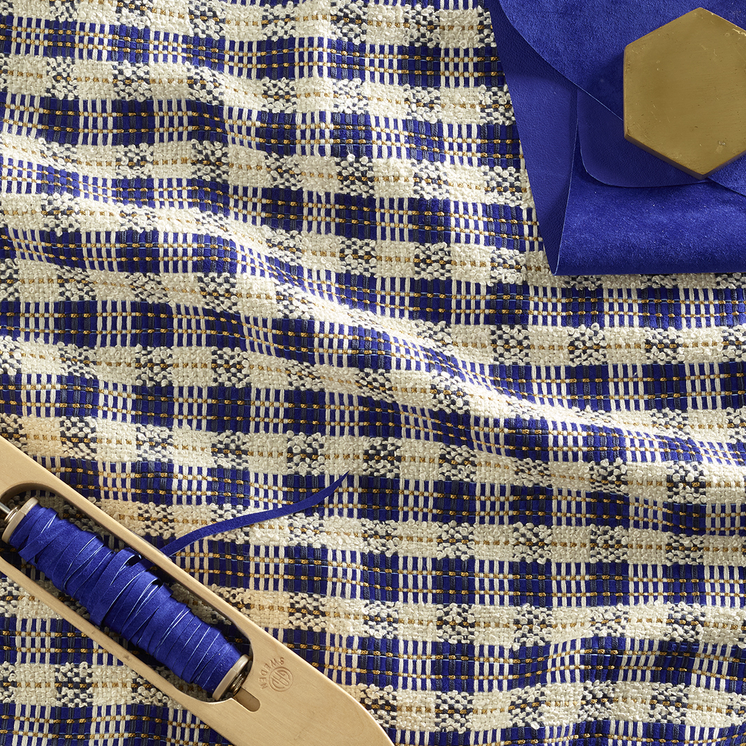 CHEQ - Cotton/Silk/Wool/Leather/Viscose.  This bold check design is woven with wide cut strips of suede and lush silk boucle.