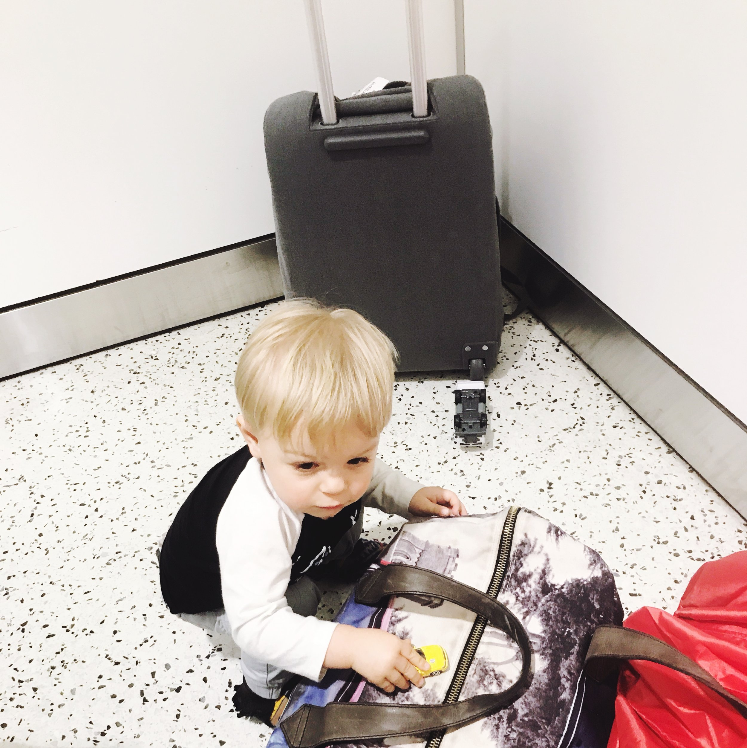 We created a play zone for Aiden to keep him busy while we waited on our luggage after finding out our flight was canceled.