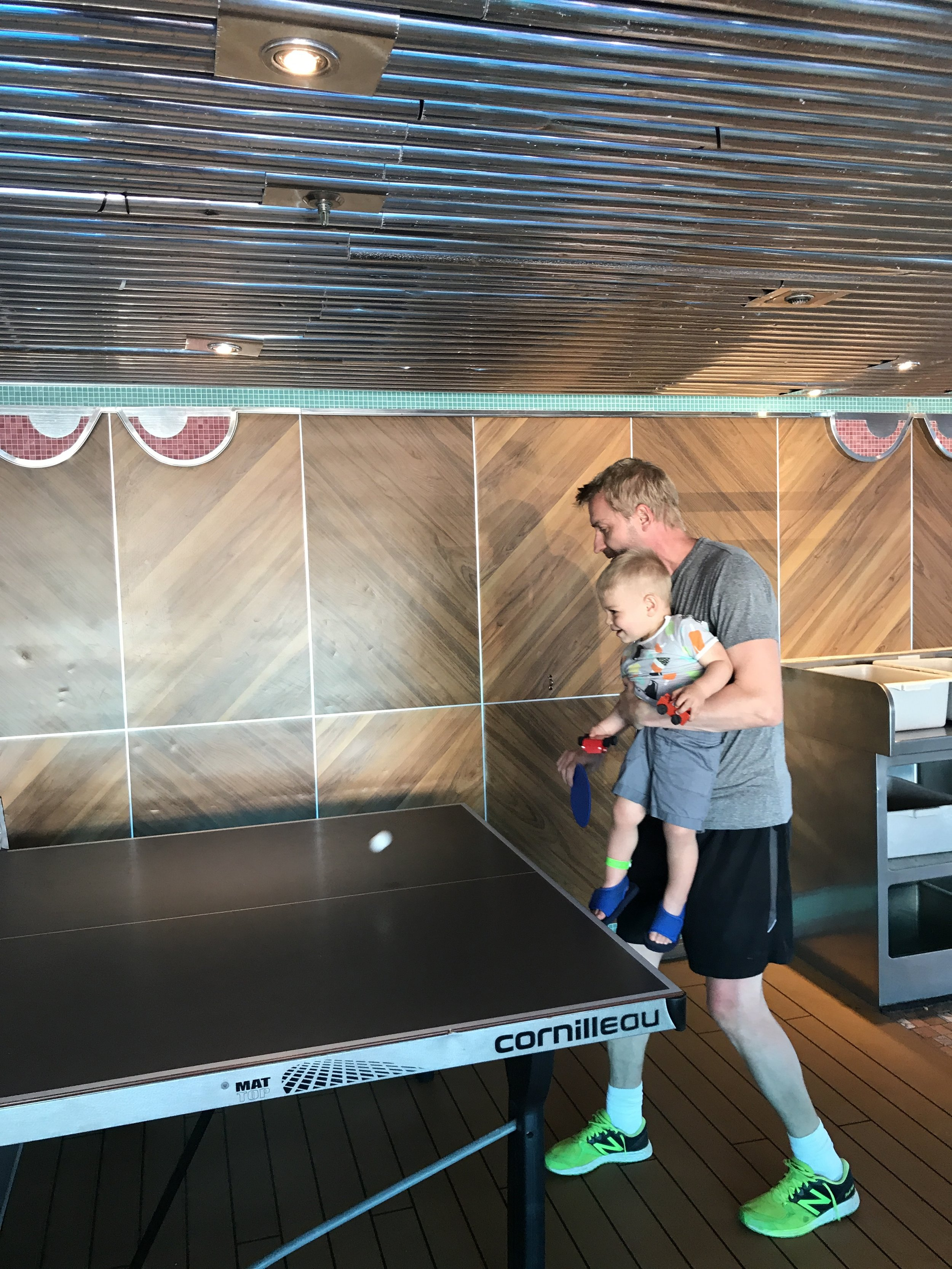Part of disconnecting is connecting with the people you love. Janne is teaching Aiden how to play ping pong!