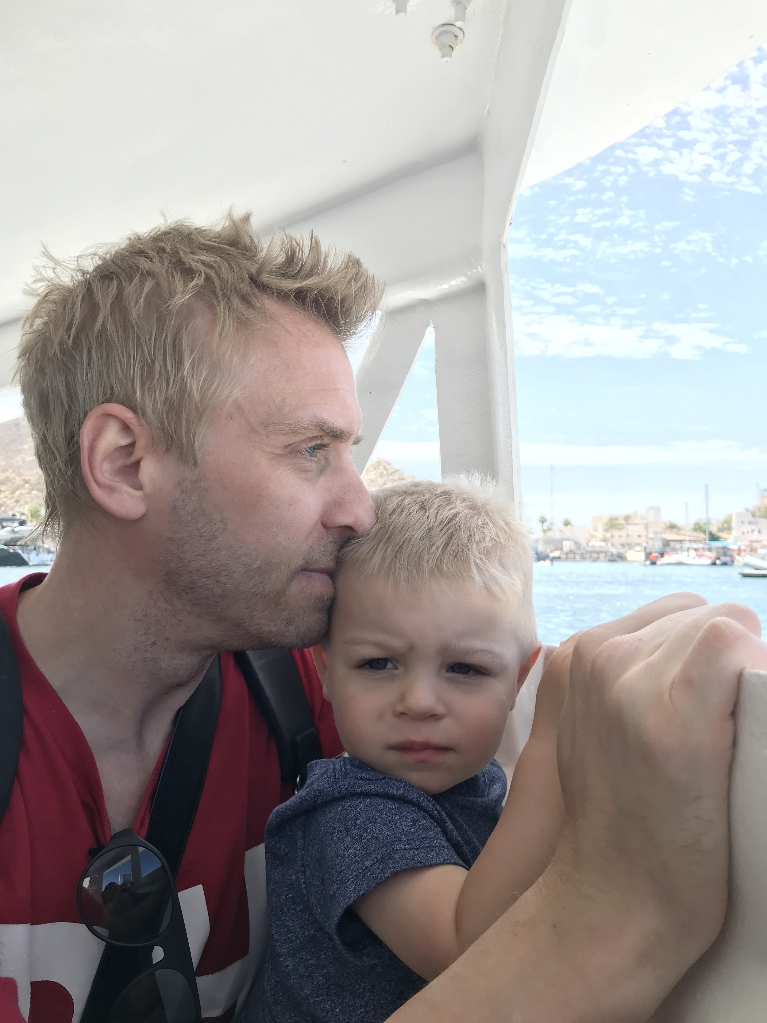 Our tired little one with  daddy  wanting anxiously to get back to our boat so he can take a nap!
