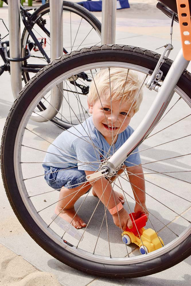 Aiden hung out solo by the bike rack for quite some time playing with his cars and a game of hide-n-seek.