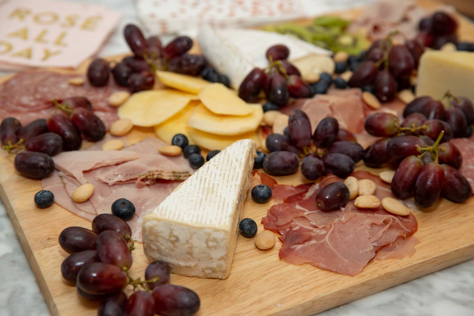 Delicious fruit, nut, meat and cheese platter created by Gina's husband