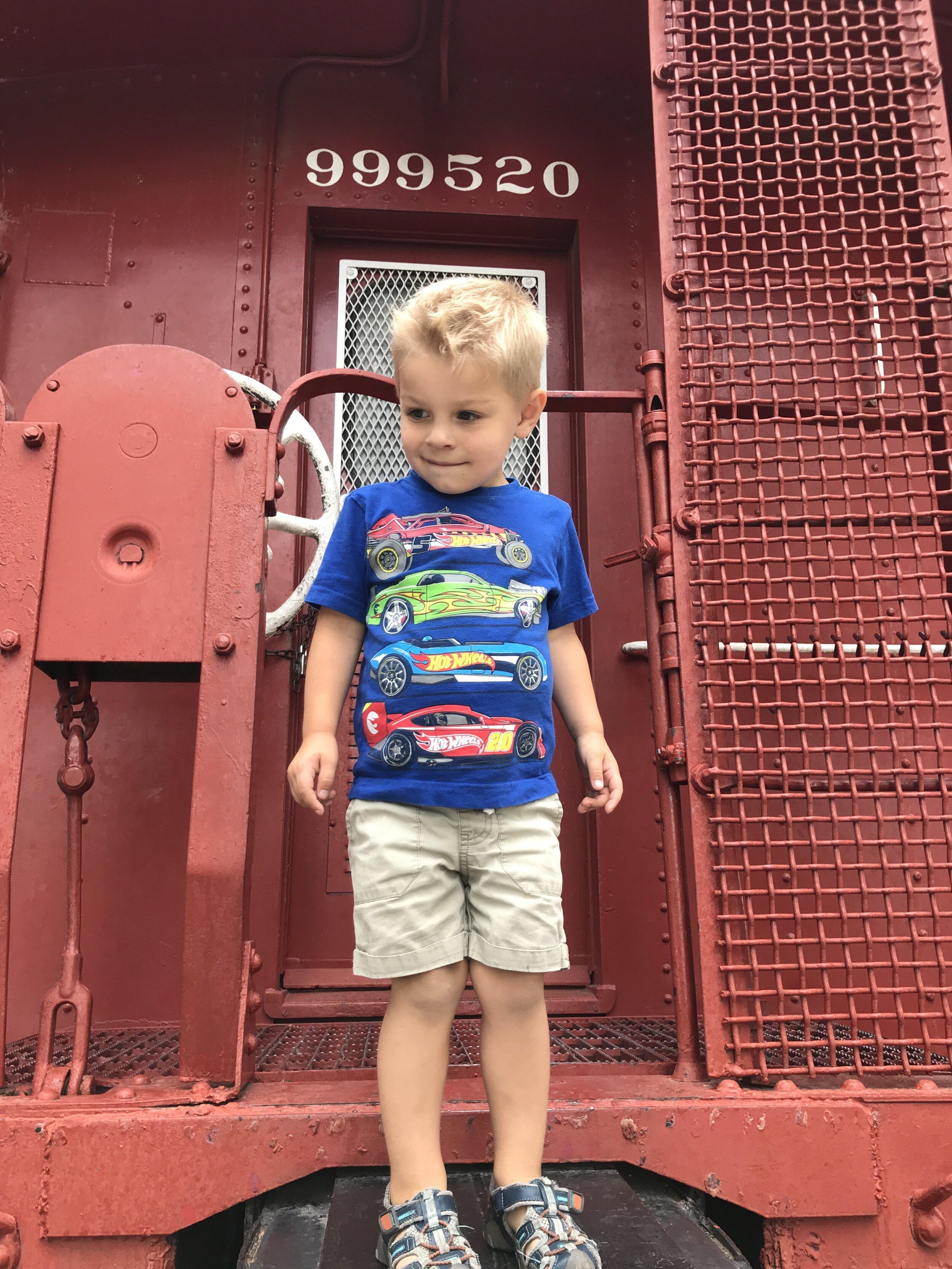 Happy boy in his element at the    train museum in Kingman, Arizona.
