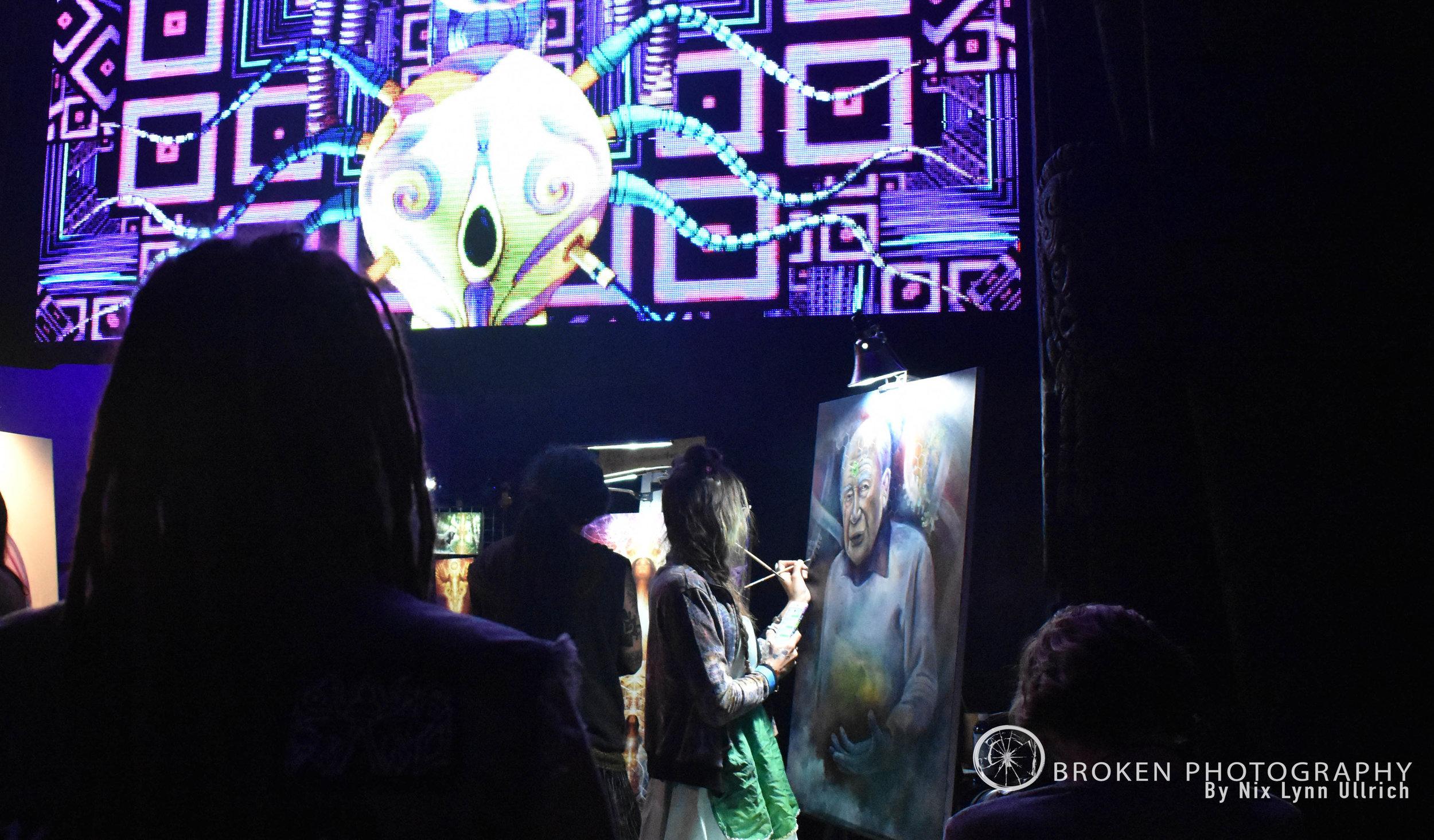 Venue Goers admiring the live artists paint.