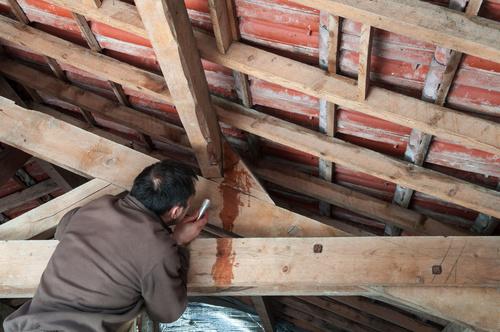 Roof Leak man in attic fotolia_108153634.jpg